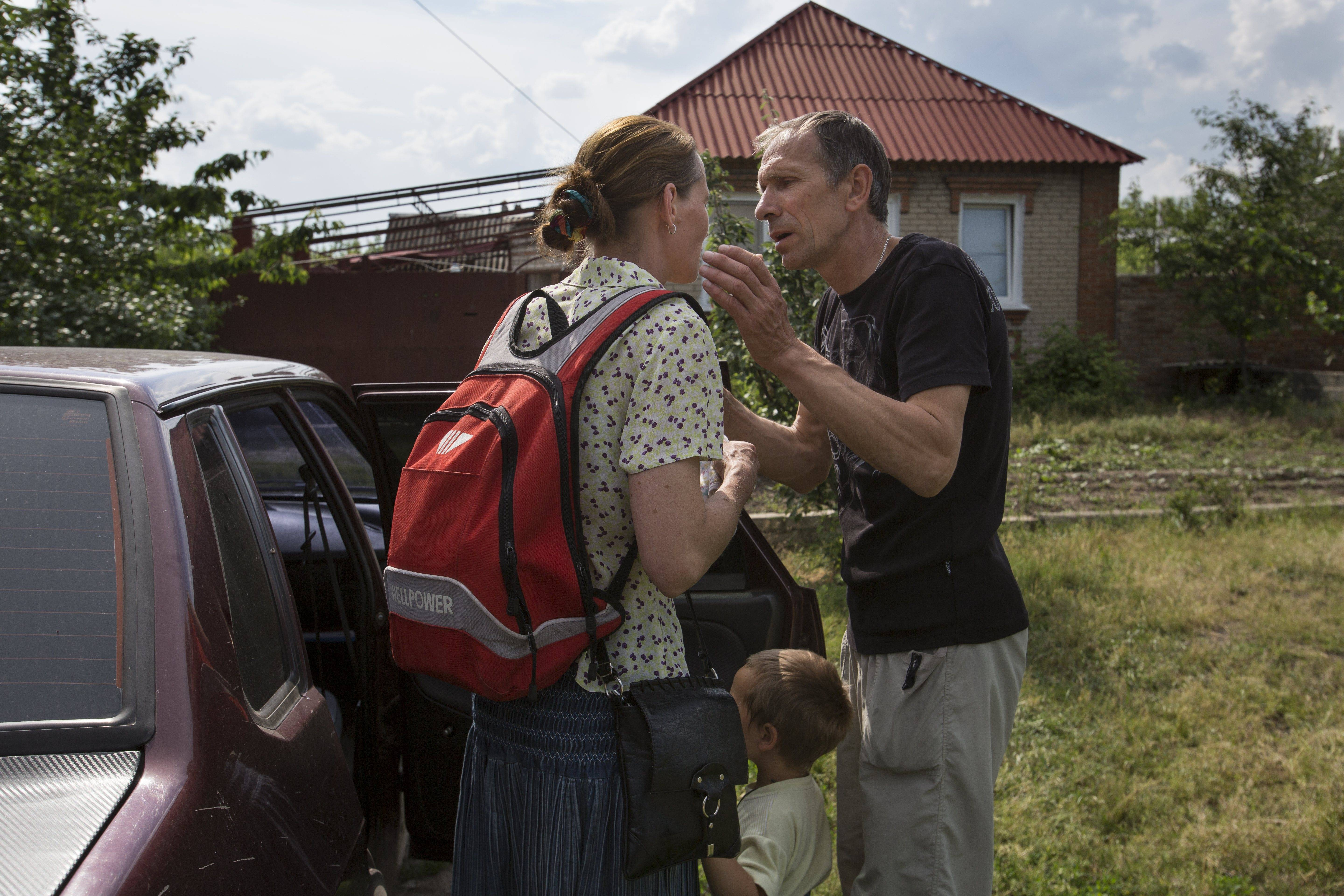 Olga Mikhailova, left, and her husband Vladimir Mikhailov kiss before abandoning their home with their children in Slovyansk, Ukraine, a city 55 miles north of Donetsk that has seen repeated clashes over the past few weeks, with residential areas coming under mortar attack Wednesday from government forces.
