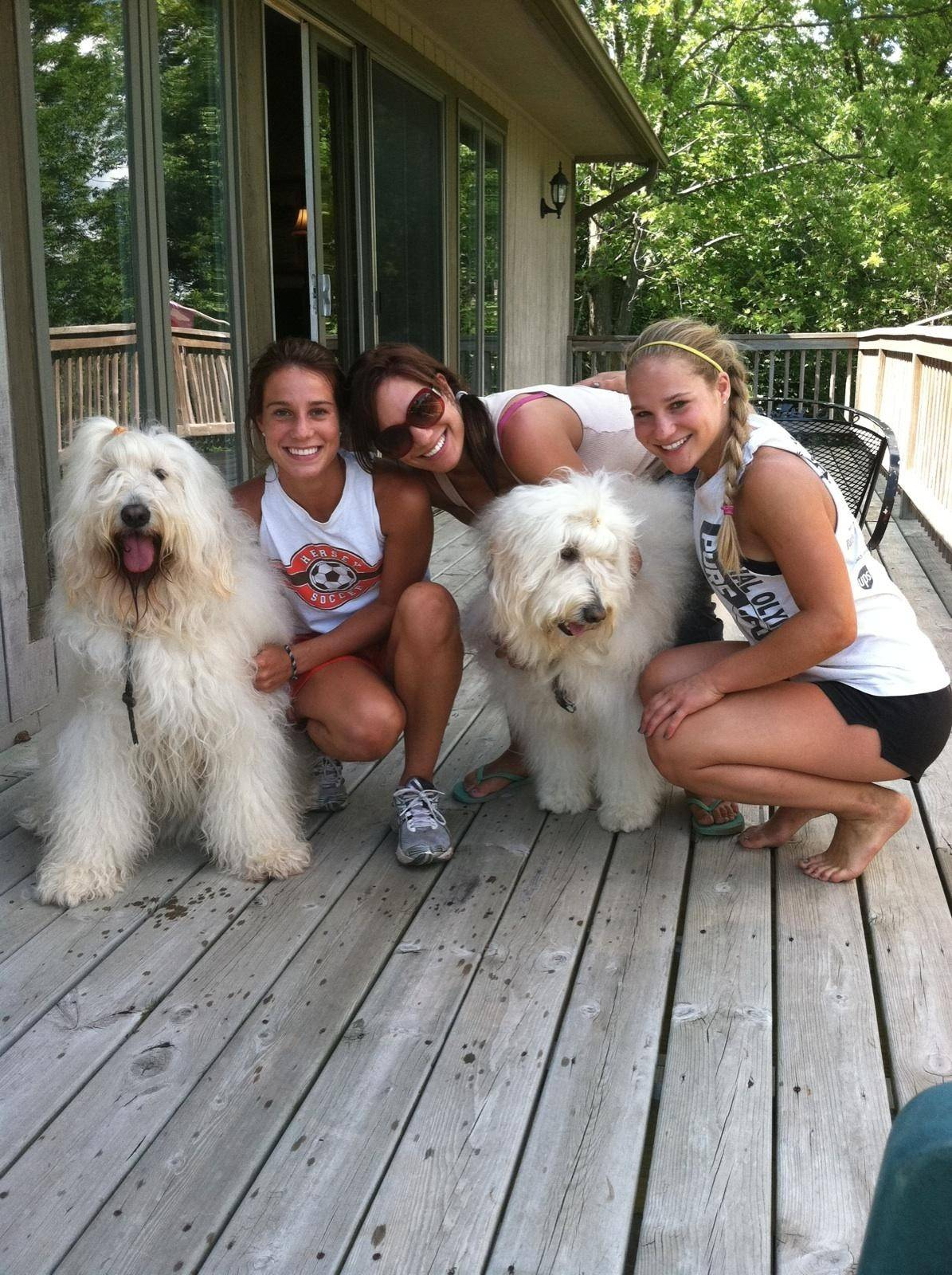 During the Giancola family's vacation in Galena a couple of months before Gina's death, sisters Domenica, left, Giovanna, center, and Gina play with dogs Lucy and Ginger in August of 2011.