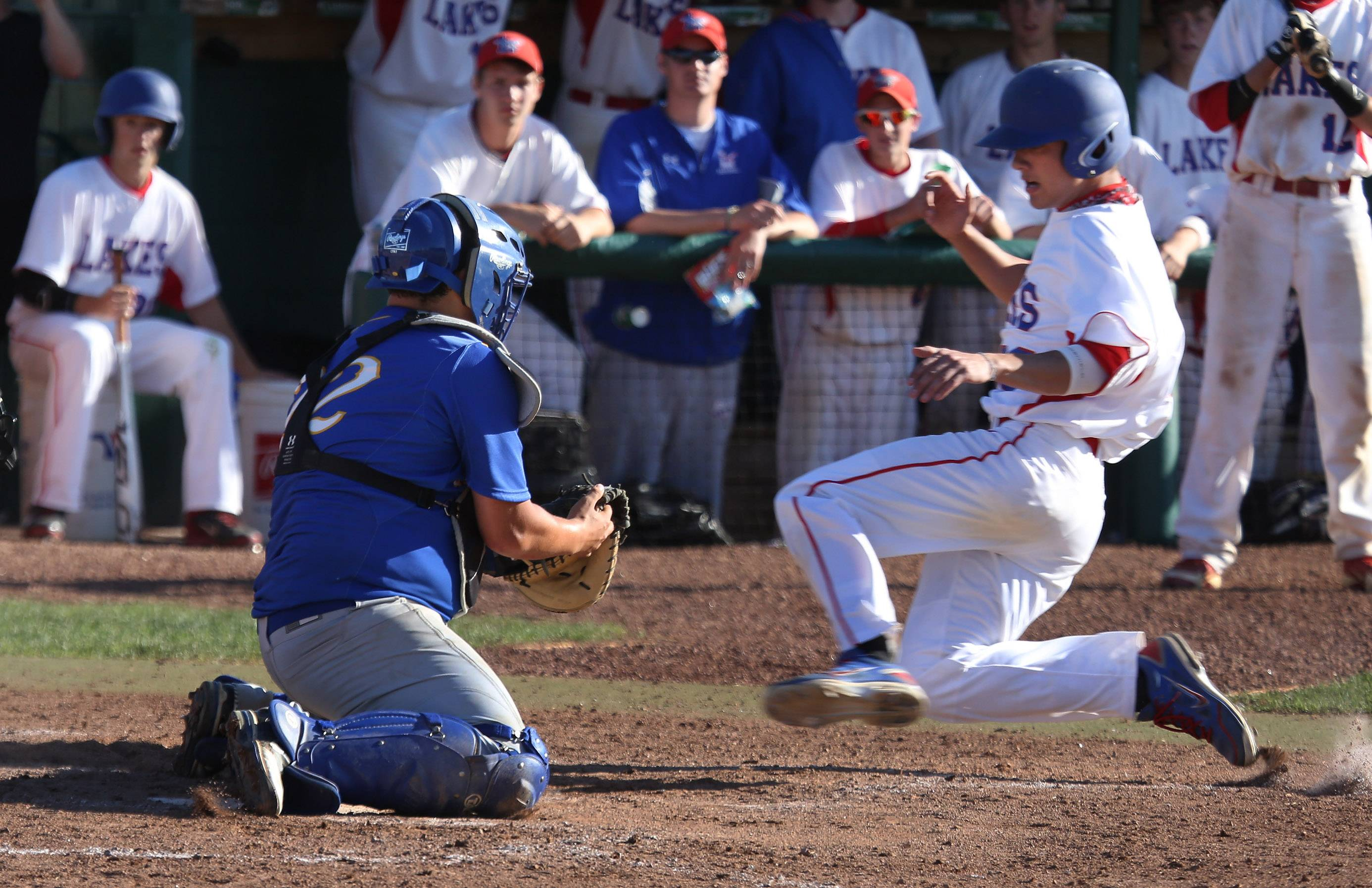 Lakes' Tyler Leon tries to slide into home plate under the tag of Johnsburg catcher B.J. Garcia in the sixth inning during the Class 3A regional semifinal game at Grayslake Central on Thursday.