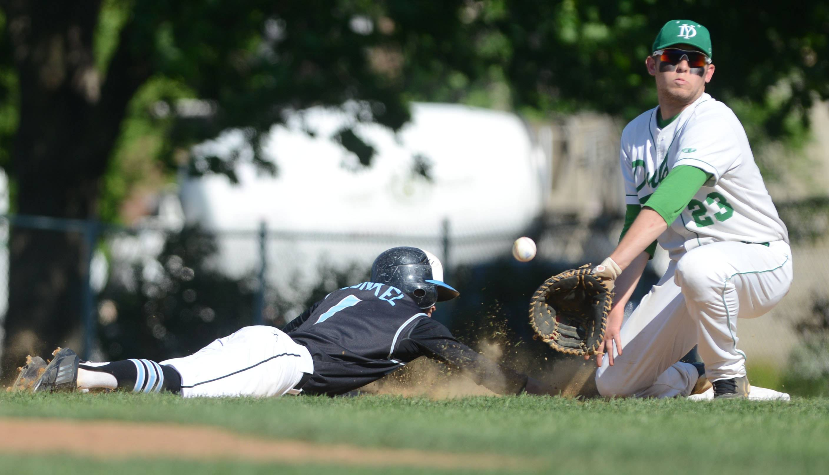 Anthony Santos of York gets ready to put the tag on Tyler Zunkel of Willowbrook during the Willowbrook at York baseball game Thursday.