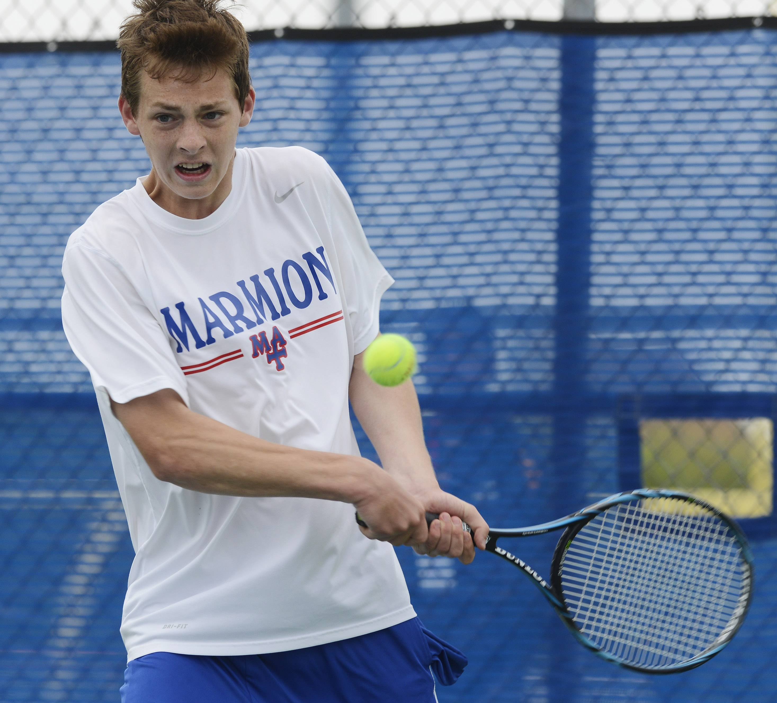 John King of Marmion Academy returns the ball during the state boys tennis tournament at Hoffman Estates High School Thursday.