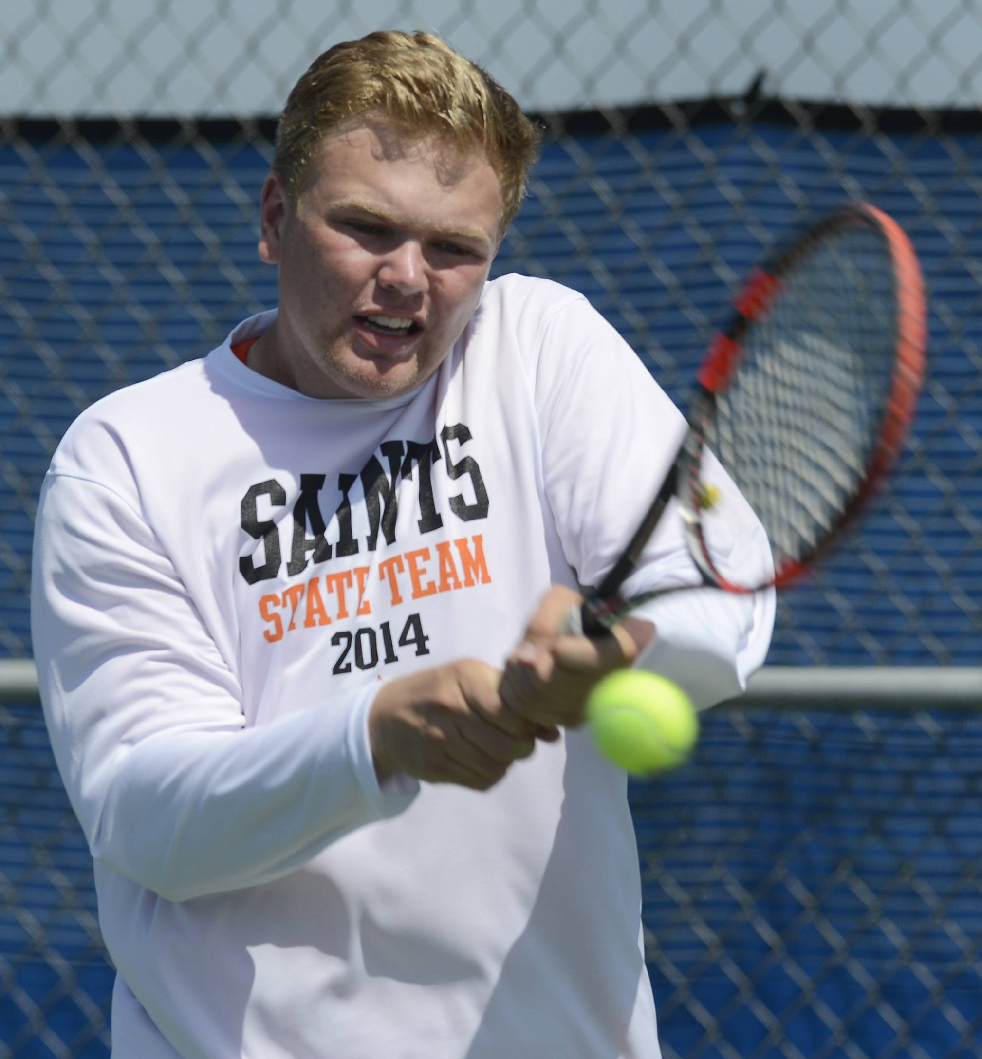 Jasper Koenen of St. Charles East returns the ball during the state boys tennis tournament at Hoffman Estates Thursday.