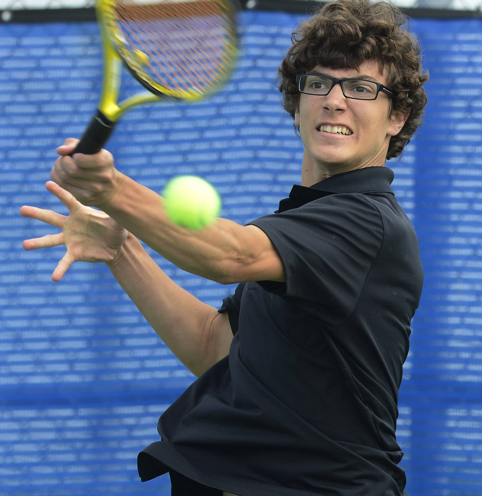 Elisha Hougland of Hampshire returns the ball during Day 1 of the boys tennis state tournament at Hoffman Estates High School on Thursday.
