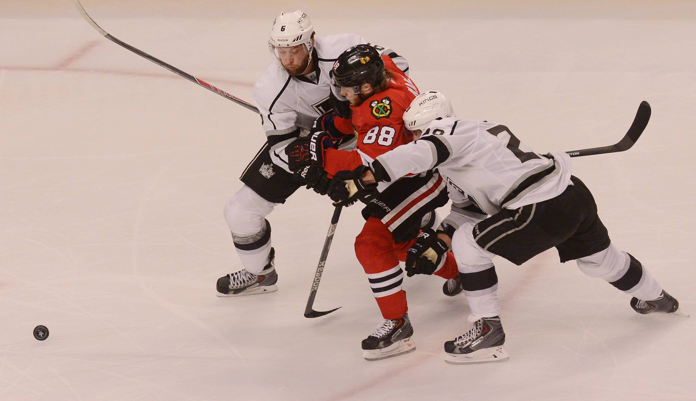 Patrick Kane is sandwiched between two in the third period of Game 5 Wednesday night at the United Center.