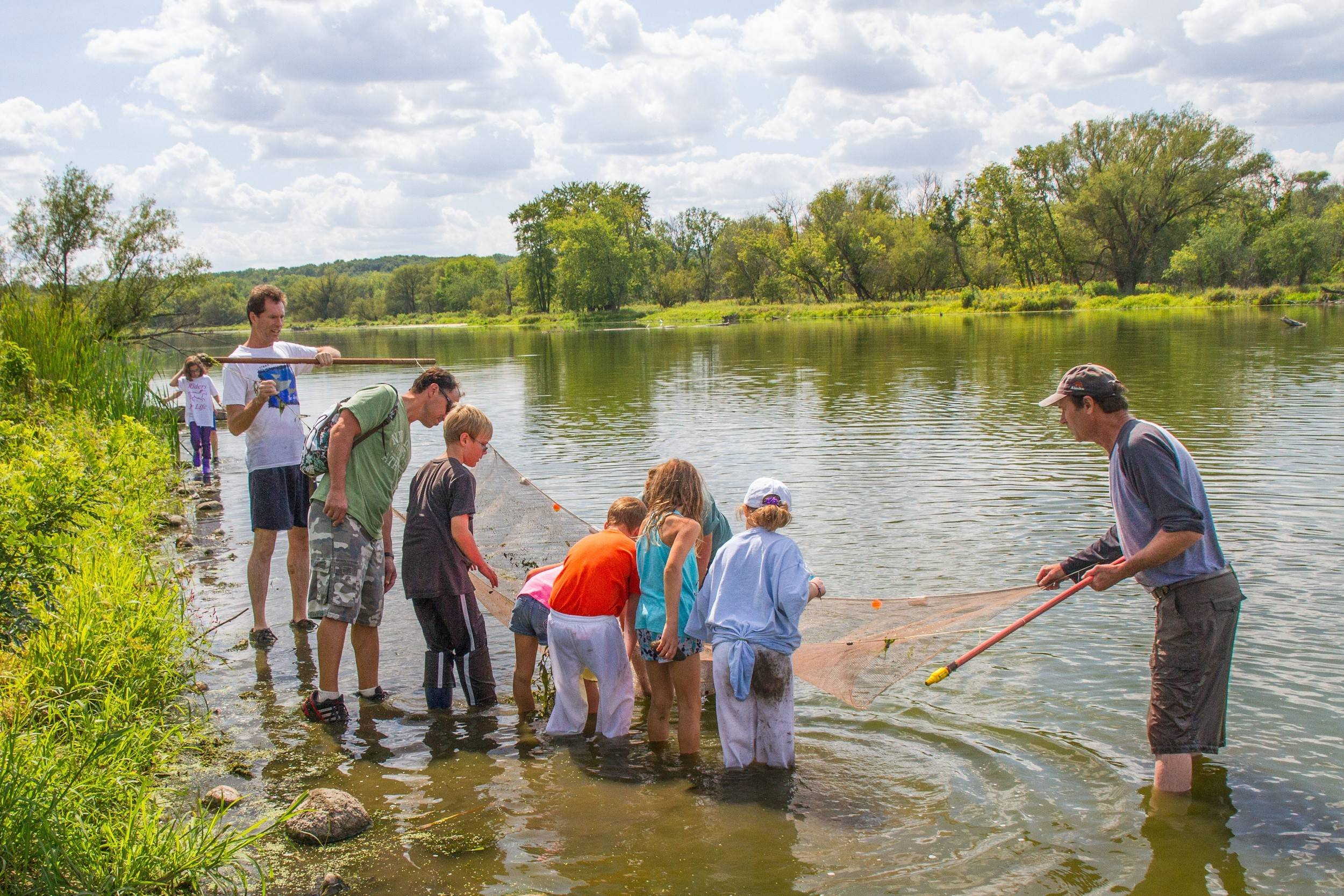 Citizens for Conservation kids and grown-ups go seining to learn what's in the stream.