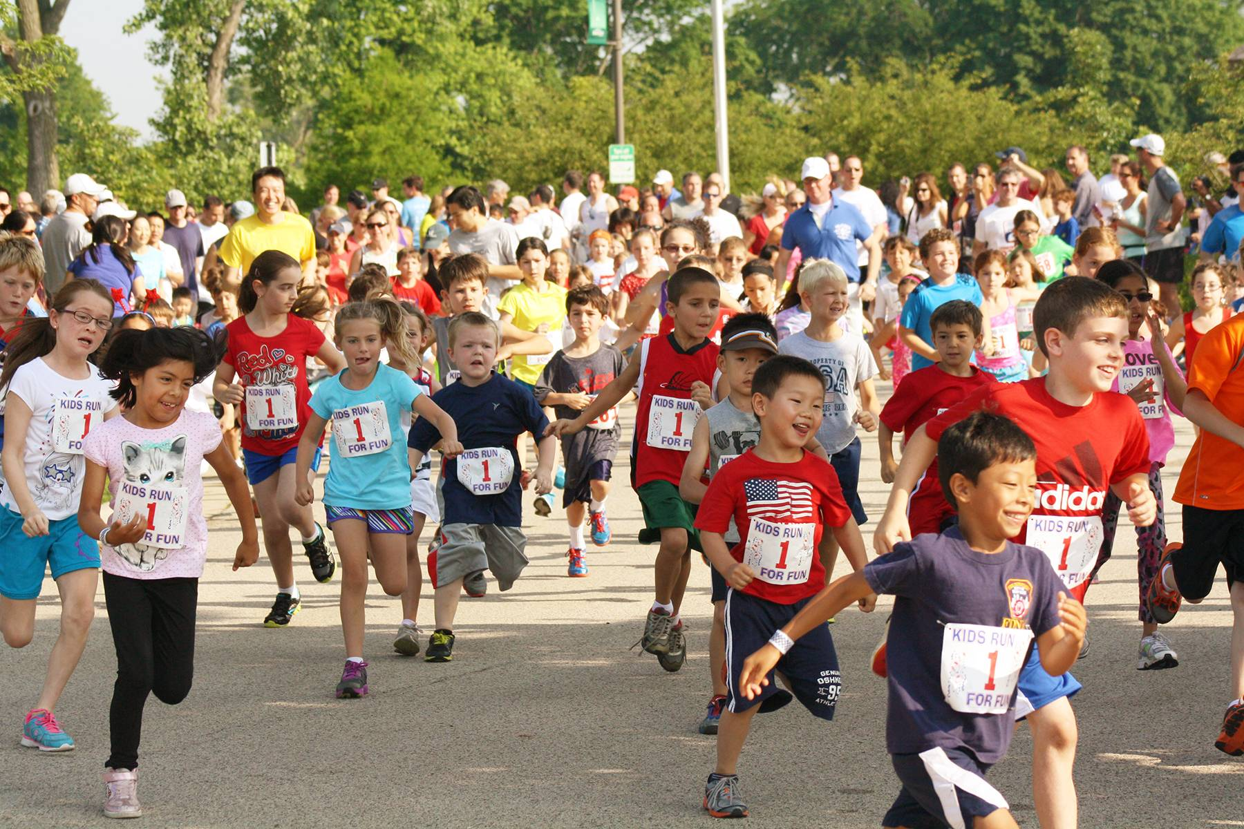 Children race during the Liberty Lap Fun Run with the Northbrook Park District on July 4, 2013.Northbrook Park District