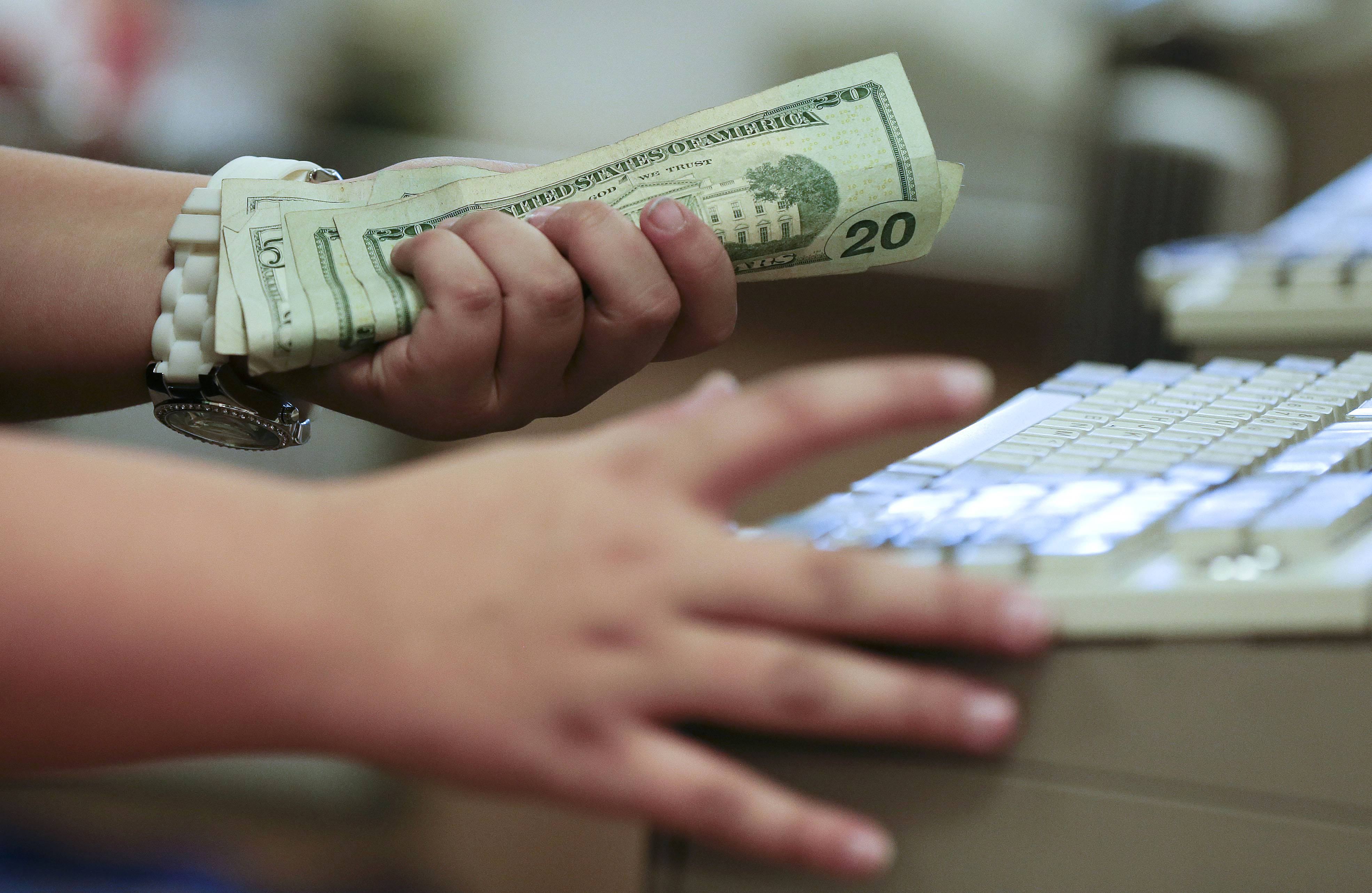 A cashier rings up a cash sale at a Sears store, in Las Vegas. The University of Michigan's index of consumer sentiment for May came in lower than expected friday.