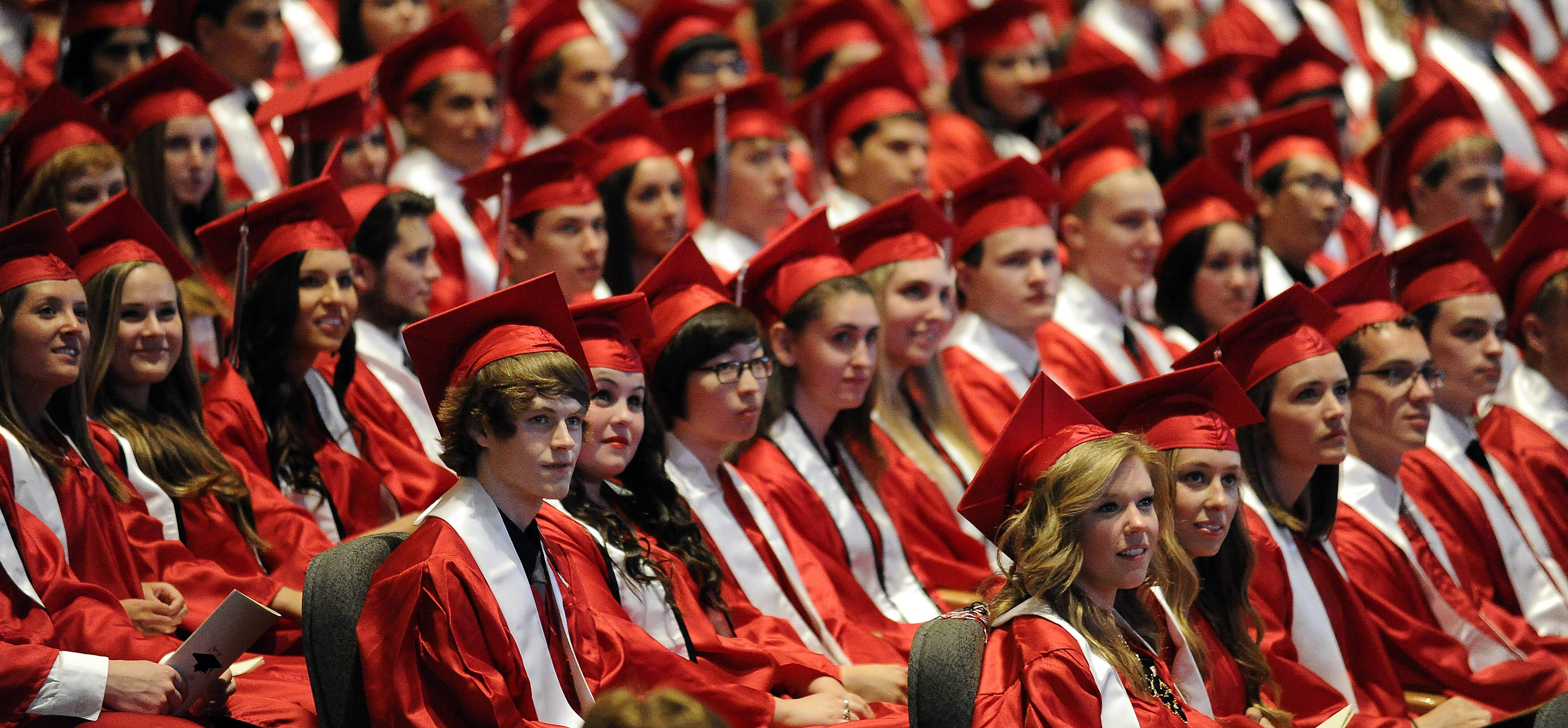 The 2014 senior class at the Barrington High School graduation ceremony looks on as the class is presented at Willow Creek Church on Friday.
