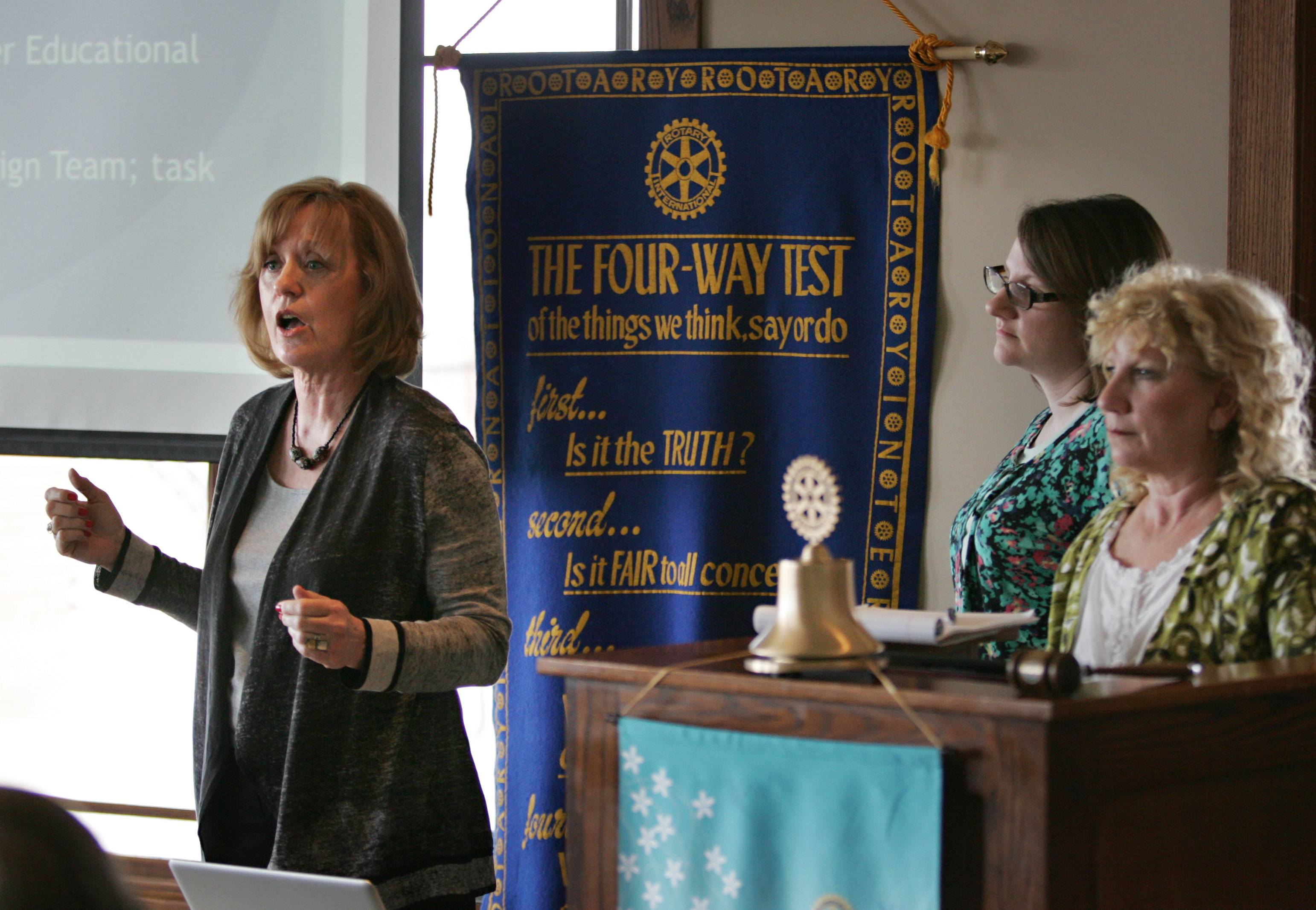 Karen Schock, president of the Elgin Charter School Initiative, talks about the group's charter school proposal last year with members of the Elgin Noon Rotary Club. Also pictured are Kari White, center, and Krissy Palermo.