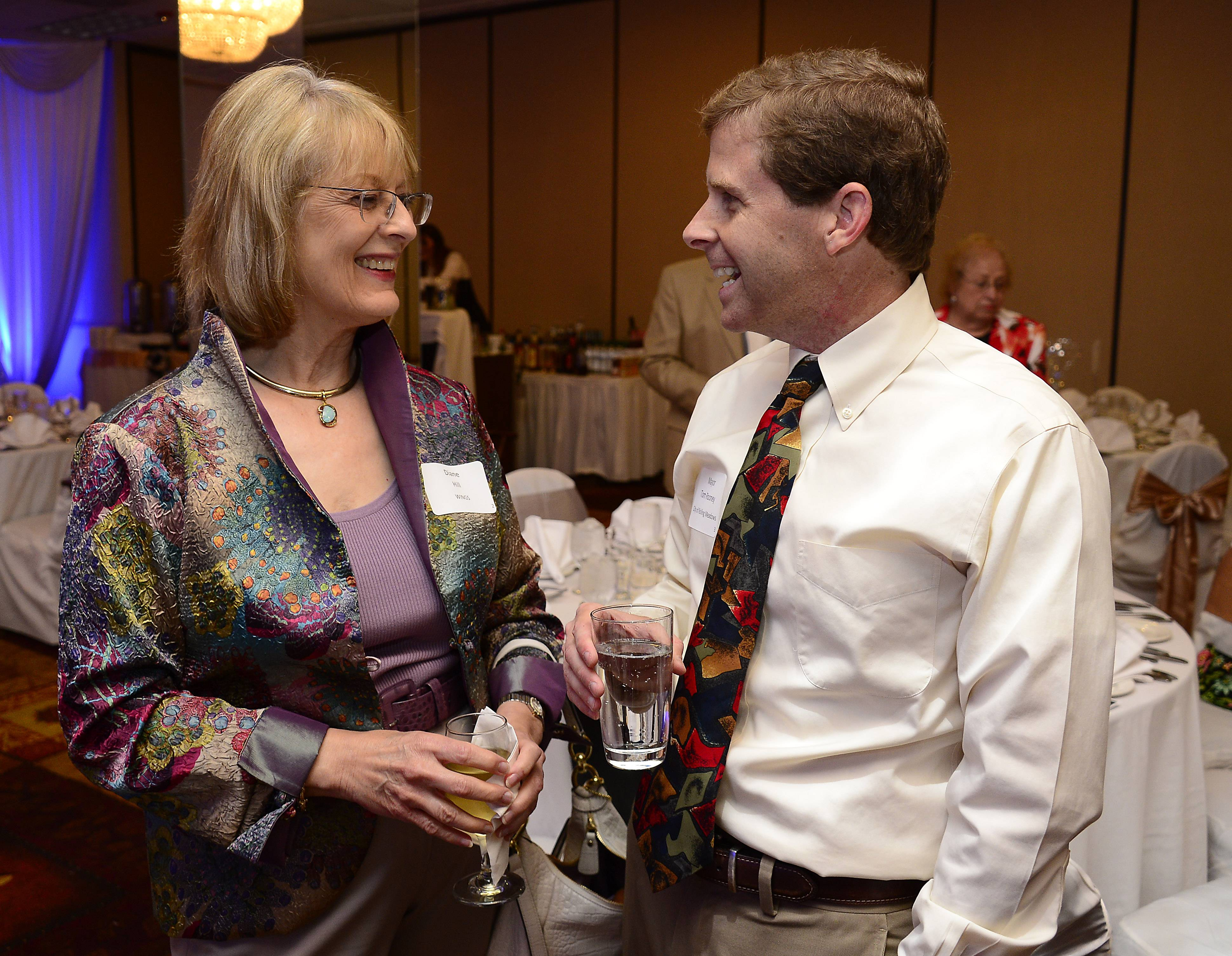 Rolling Meadows Mayor Tom Rooney talks with Diane Hill of WINGS at the Rolling Meadows Chamber of Commerce recognition dinner on Thursday.