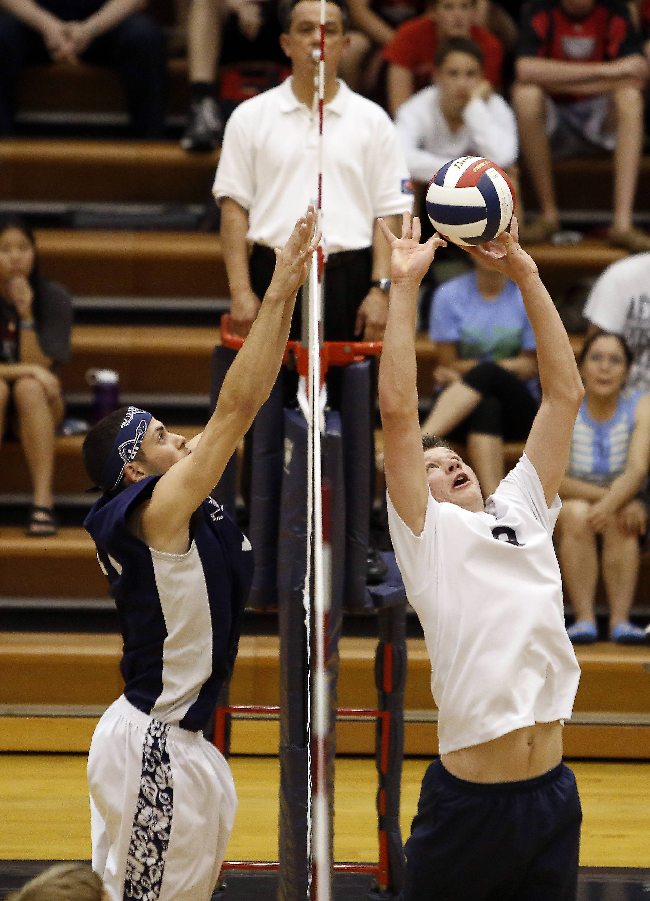 Lake Park's Dominick Terry 16 goes for the block against Addison Trail's Kevin Grygo 9 during boys volleyball at Conant sectional semifinals Friday in Hoffman Estates.