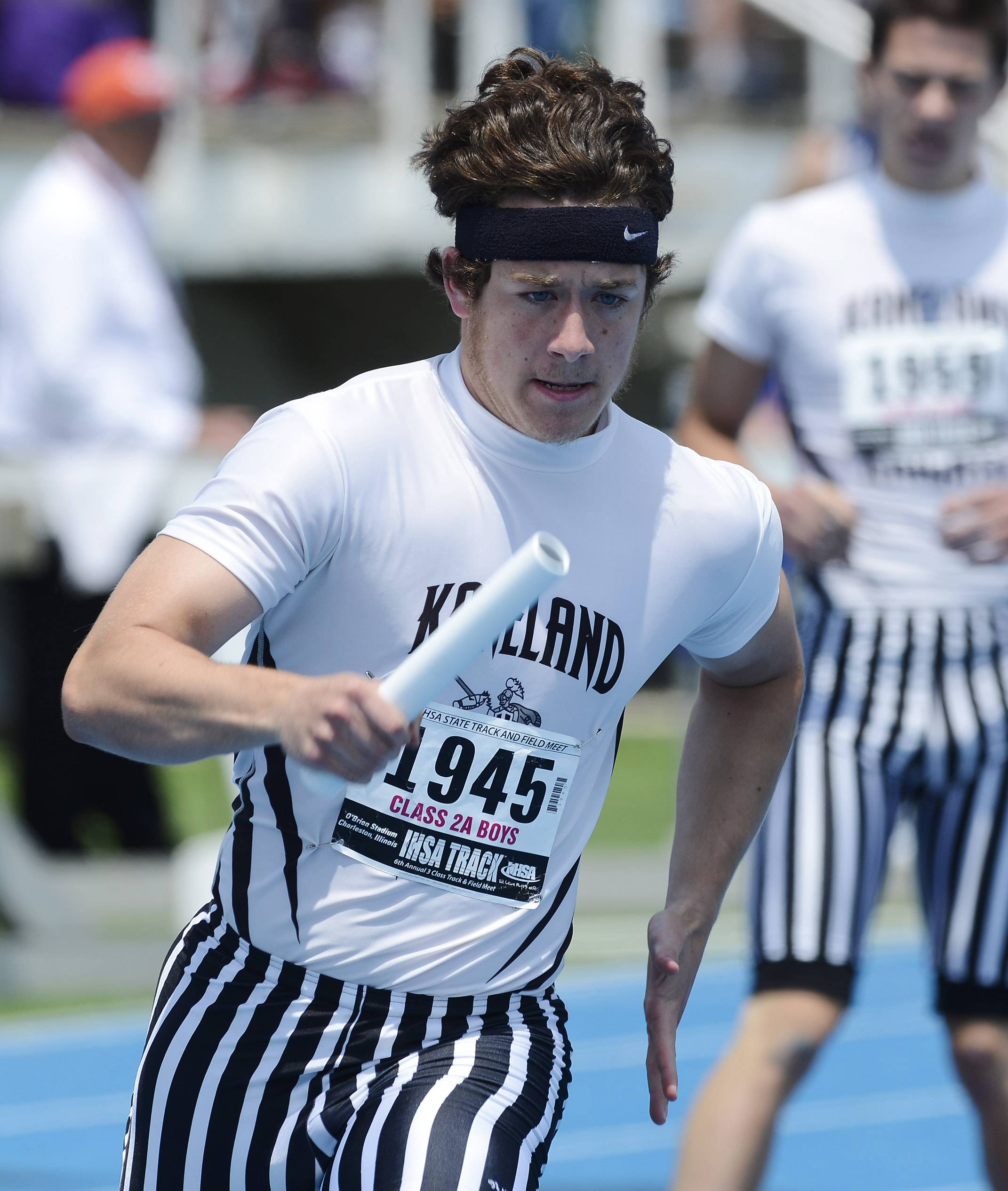 Brandon Bishop of Kaneland carries the baton for his team in the 4x400-meter relay during the Class 2A boys track and field state preliminaries in Charleston on Friday.