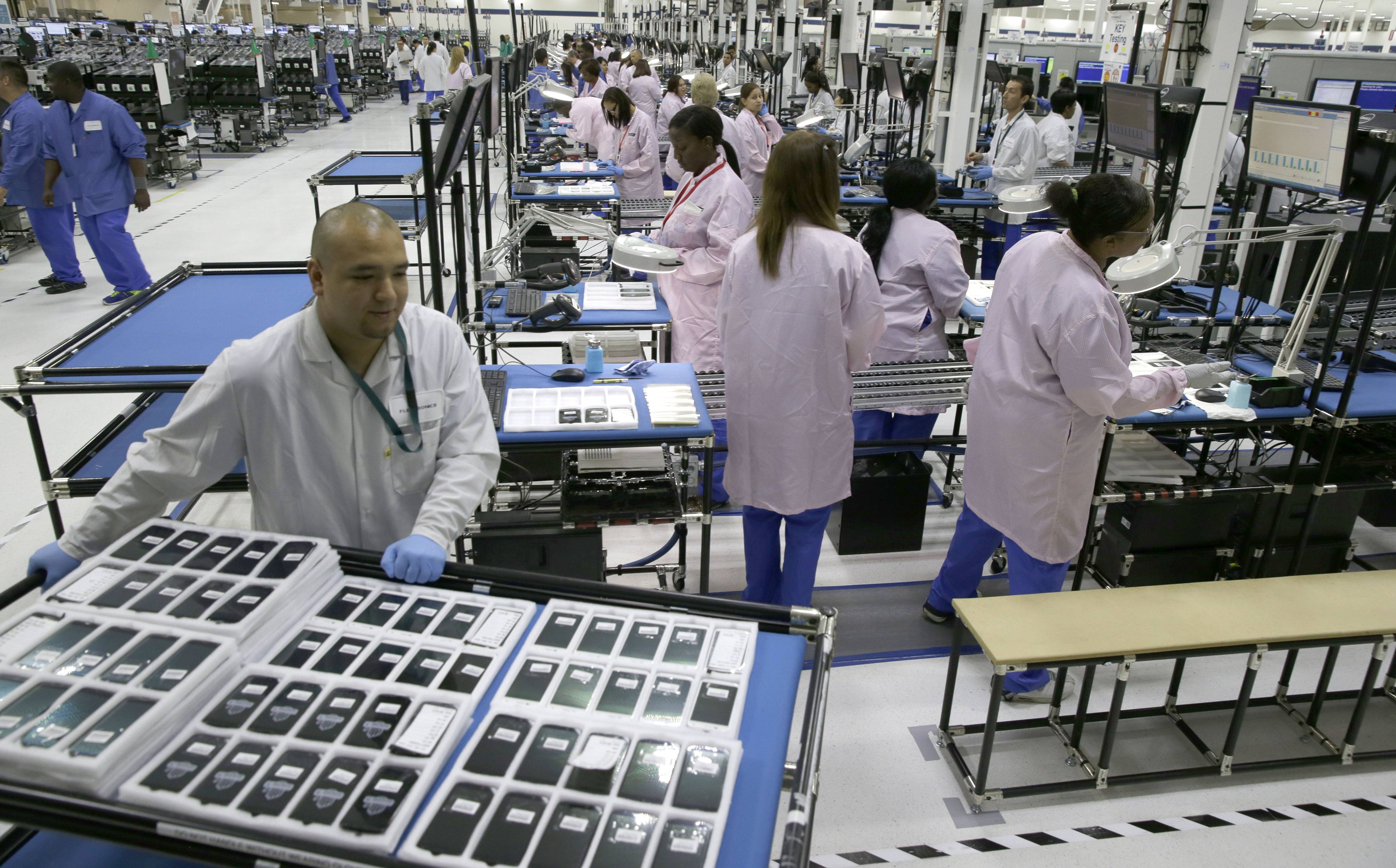 Workers man the Motorola smartphone plant in Fort Worth, Texas. Cellphone pioneer Motorola has announced it's closing a Texas manufacturing facility just a year after announcing its opening.