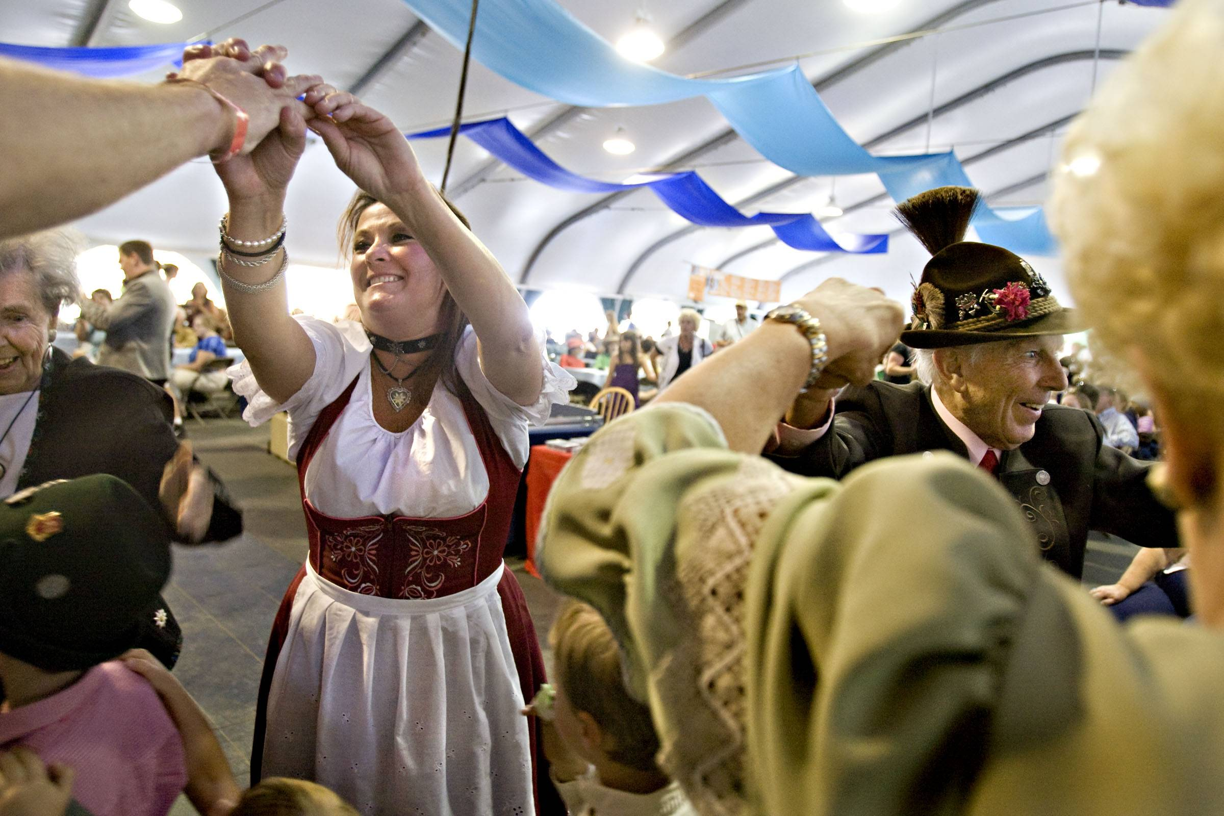 People enjoy dancing to the Bavarian musical group Alpiners USA as part of the Oktoberfest celebration at Snowbird Mountain Resort in Utah. Utah's state liquor commission is tightening up on issuing permits for weekend events like Snowbird Ski Resort's annual Oktoberfest.