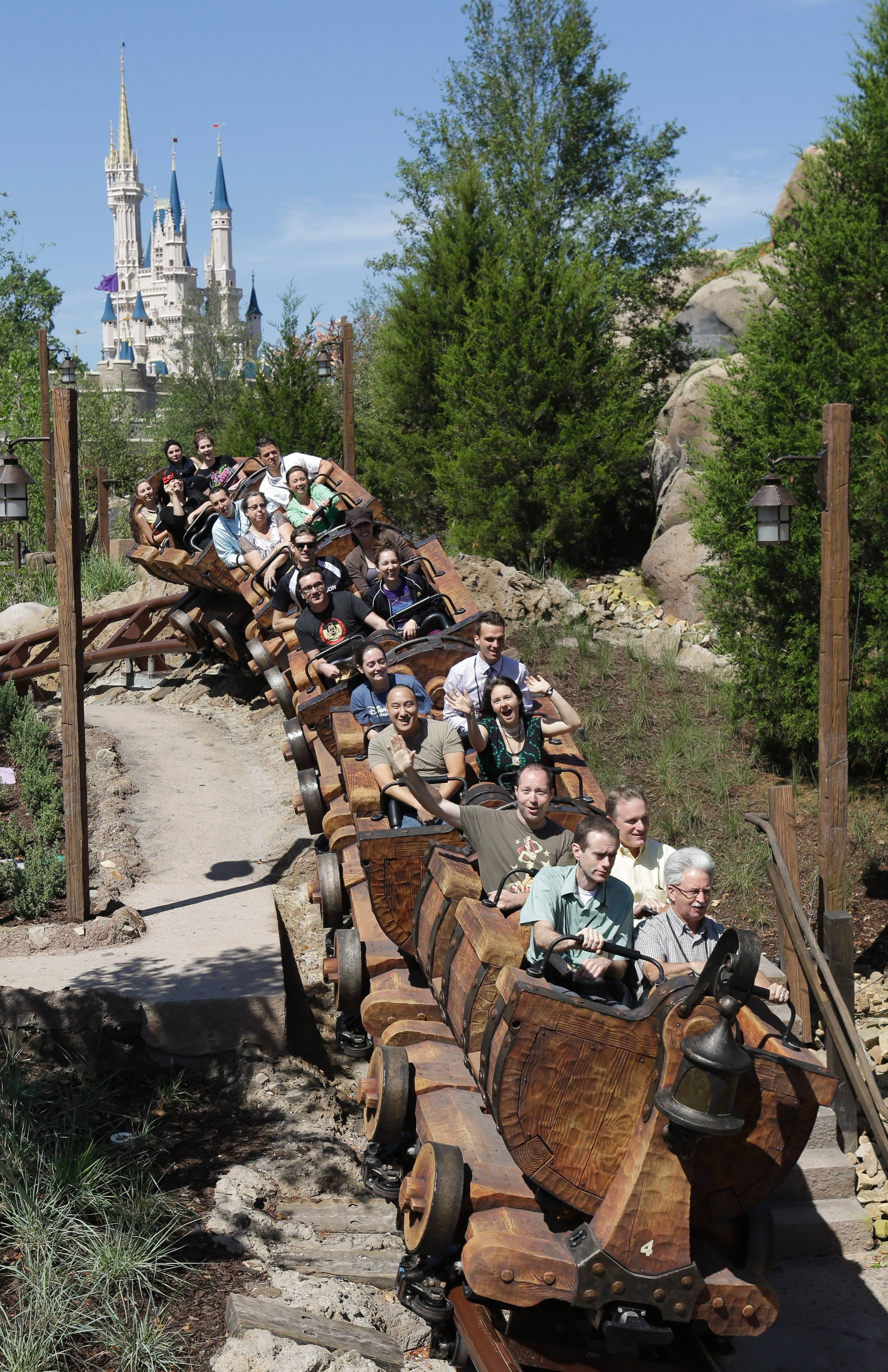 Disney cast members test the new Seven Dwarfs Mine Train roller coaster in the Magic Kingdom at Walt Disney World in Lake Buena Vista, Fla. The ride opened Wednesday.