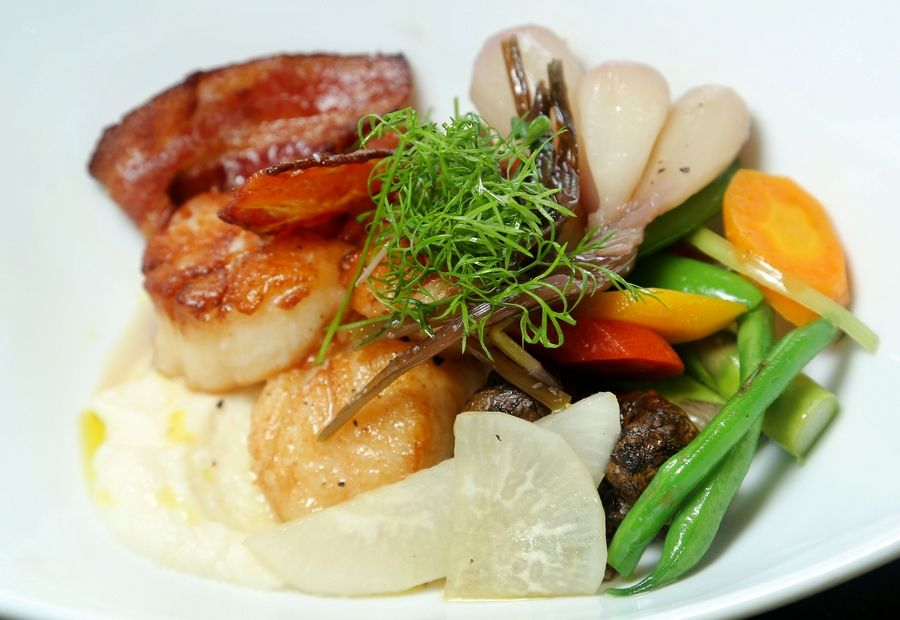 Chef Rick Starr pairs day boat scallops with seasonal vegetables at Ad-Lib Geo Cafe in Lindenhurst.