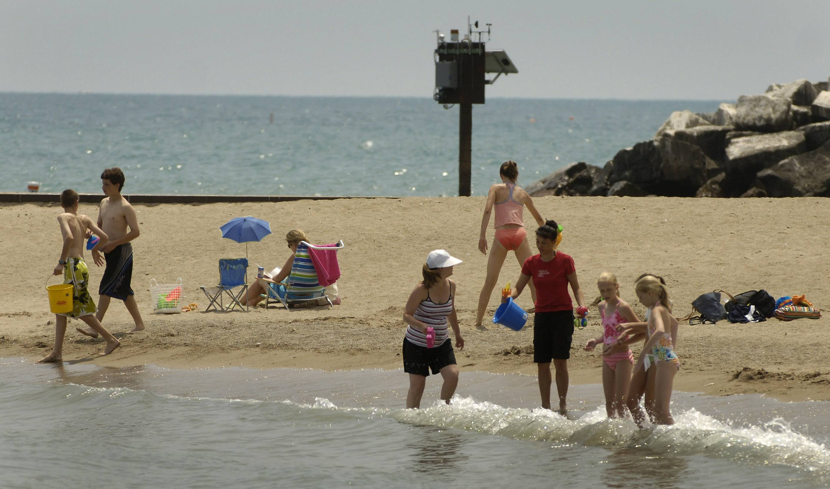 Visitors to Forest Park Beach in Lake Forest enjoy the sand and water. Beachgoers can get updates on conditions at local beaches trough the Lake County Health Department/Community Health Center's website.