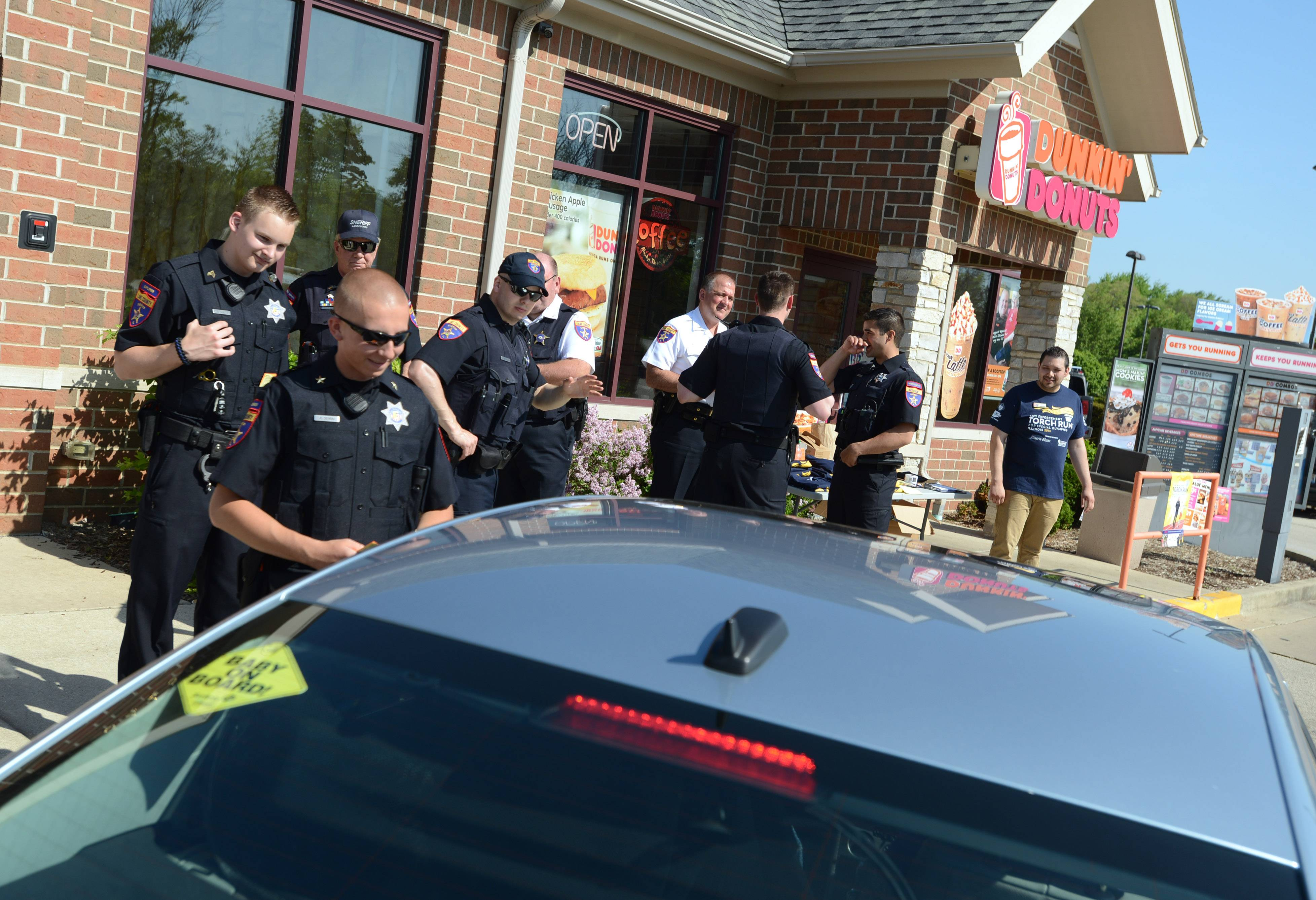 Members of the Lake County sheriff's office participate in Cop on Rooftop Friday morning at the Third Lake Dunkin' Donuts to raise money for the Law Enforcement Torch Run to benefit Special Olympids Illinois.