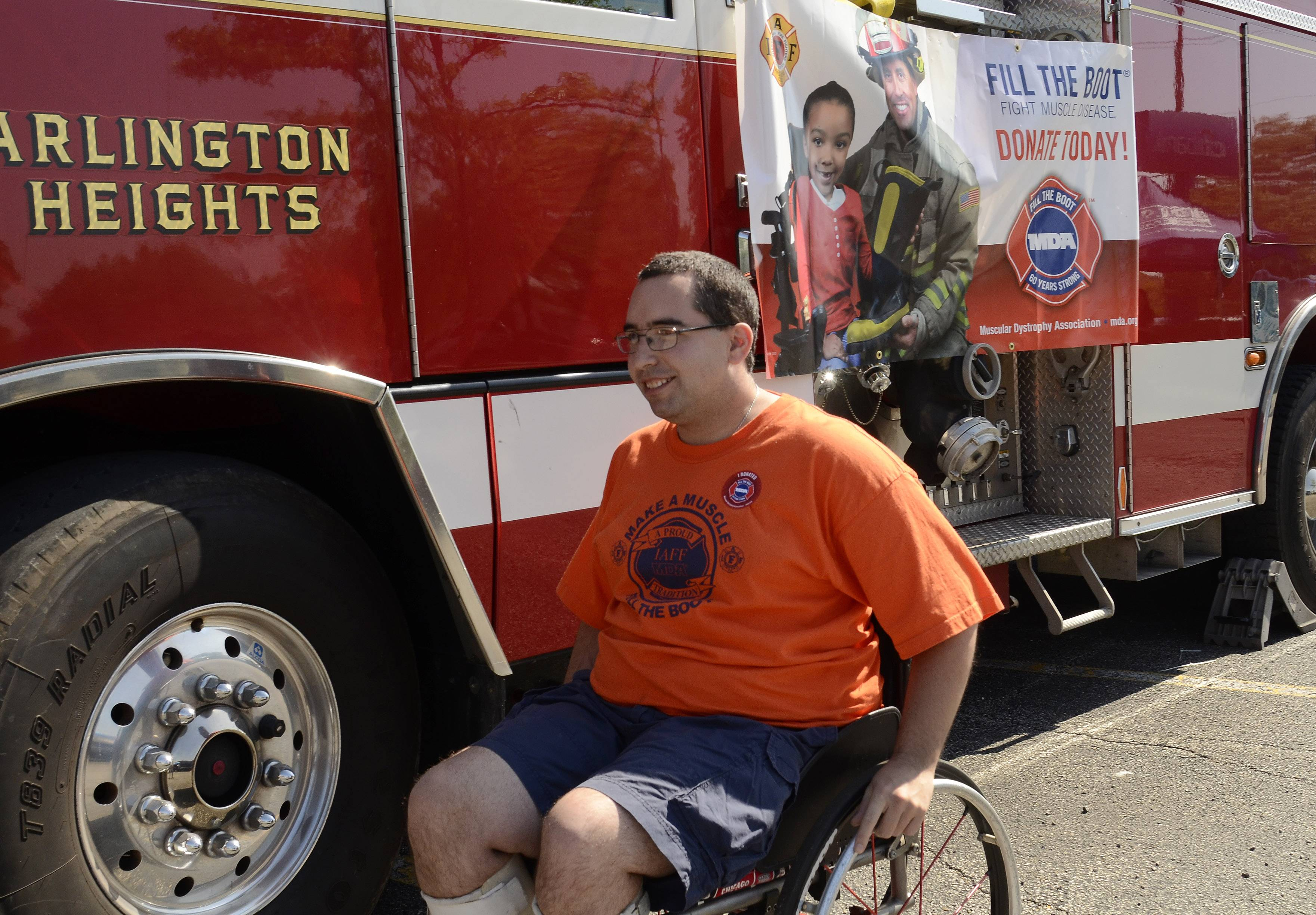 Seth Goldberg of Arlington Heights is the MDA ambassador for the Arlington Heights firefighters Fill the Boot campaign for the 5th year, working Friday at the intersection of Palatine and Arlington Heights Roads.