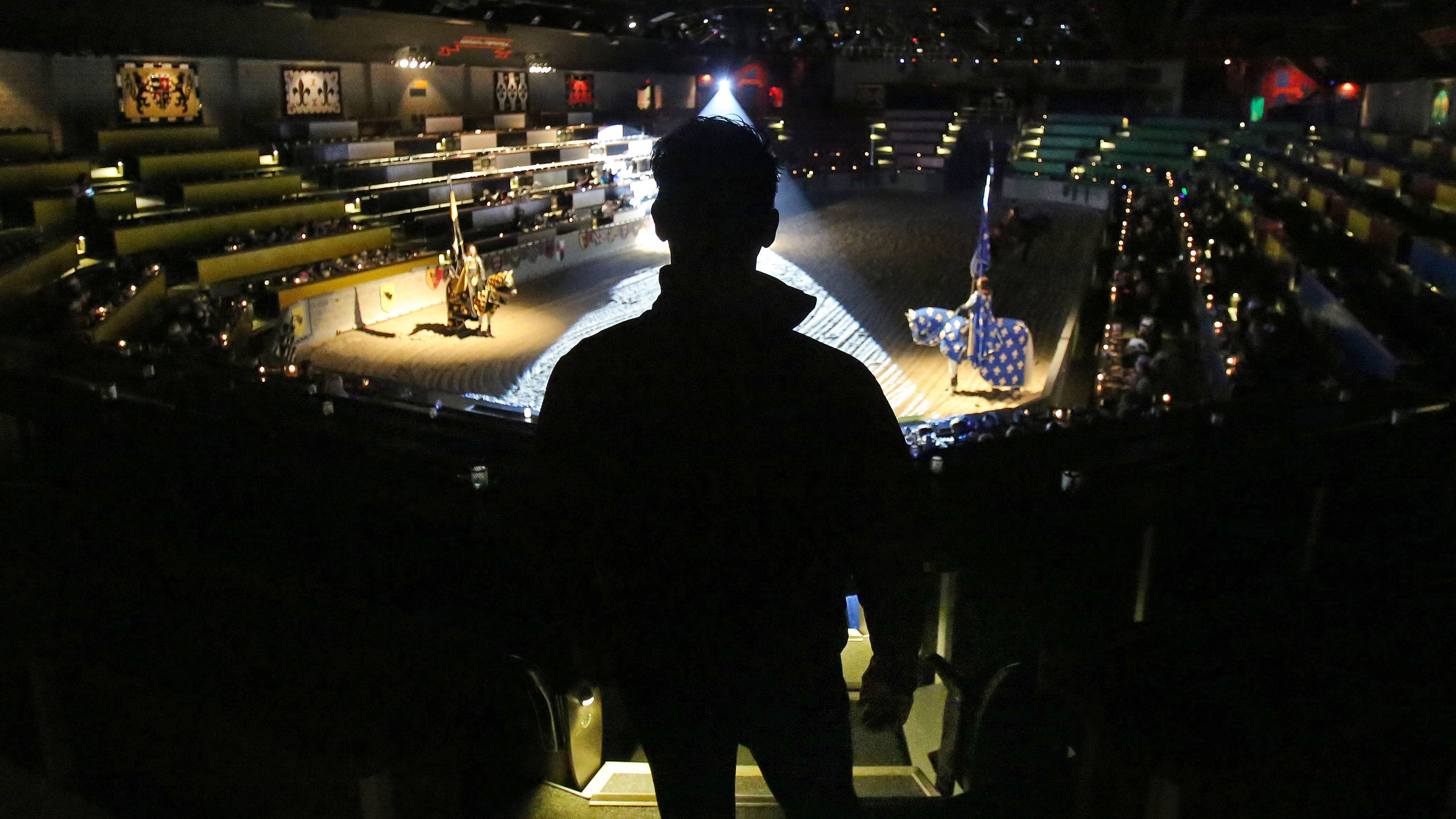 Mario Contreras watches a recent show at Medieval Times in Hoffman Estates, where he is the head horse trainer.