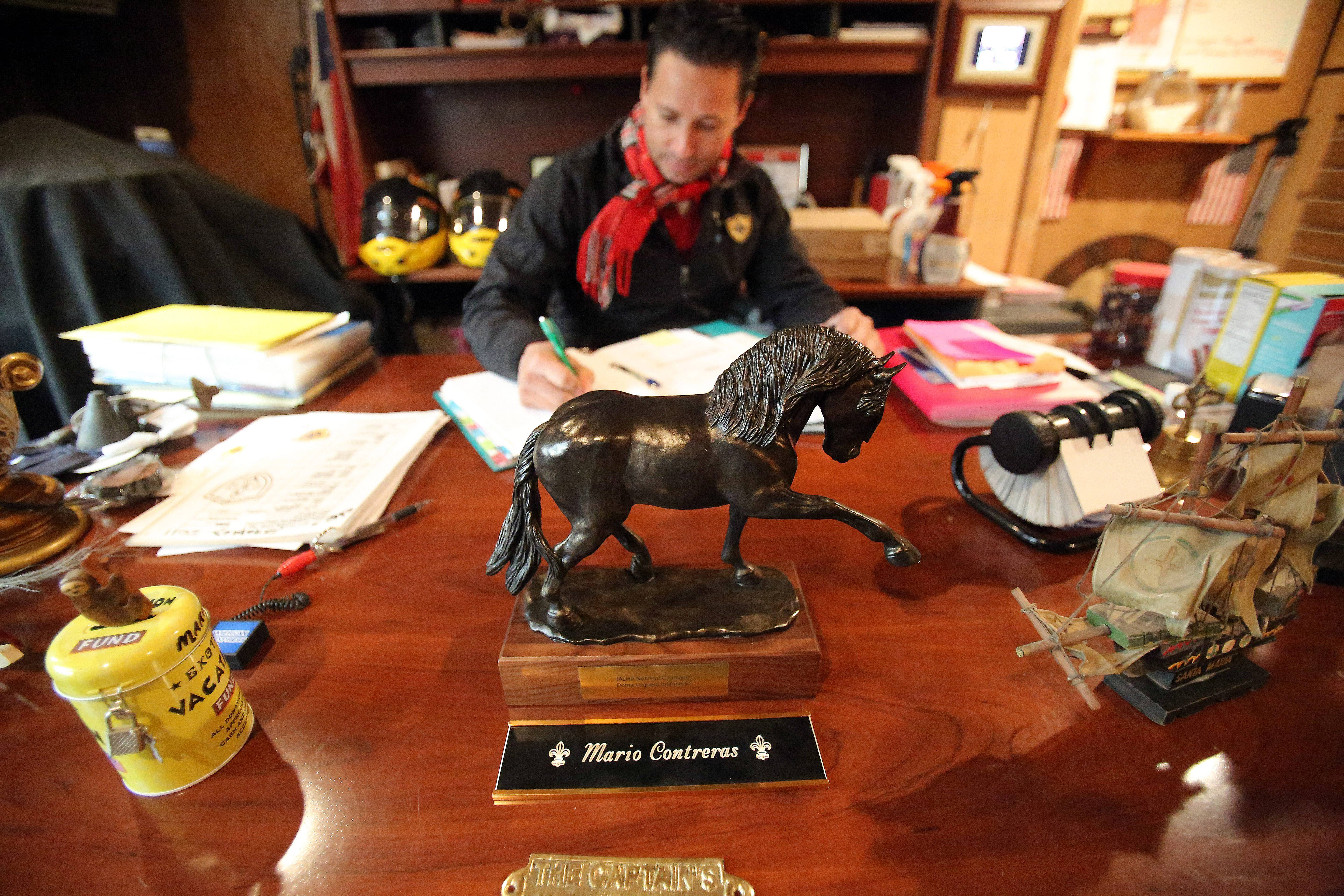 Contreras at his office in the Indian Hills Training Center in Gilberts, where he holds his private horse training sessions. He is one of the most decorated horse trainers in the Midwest.