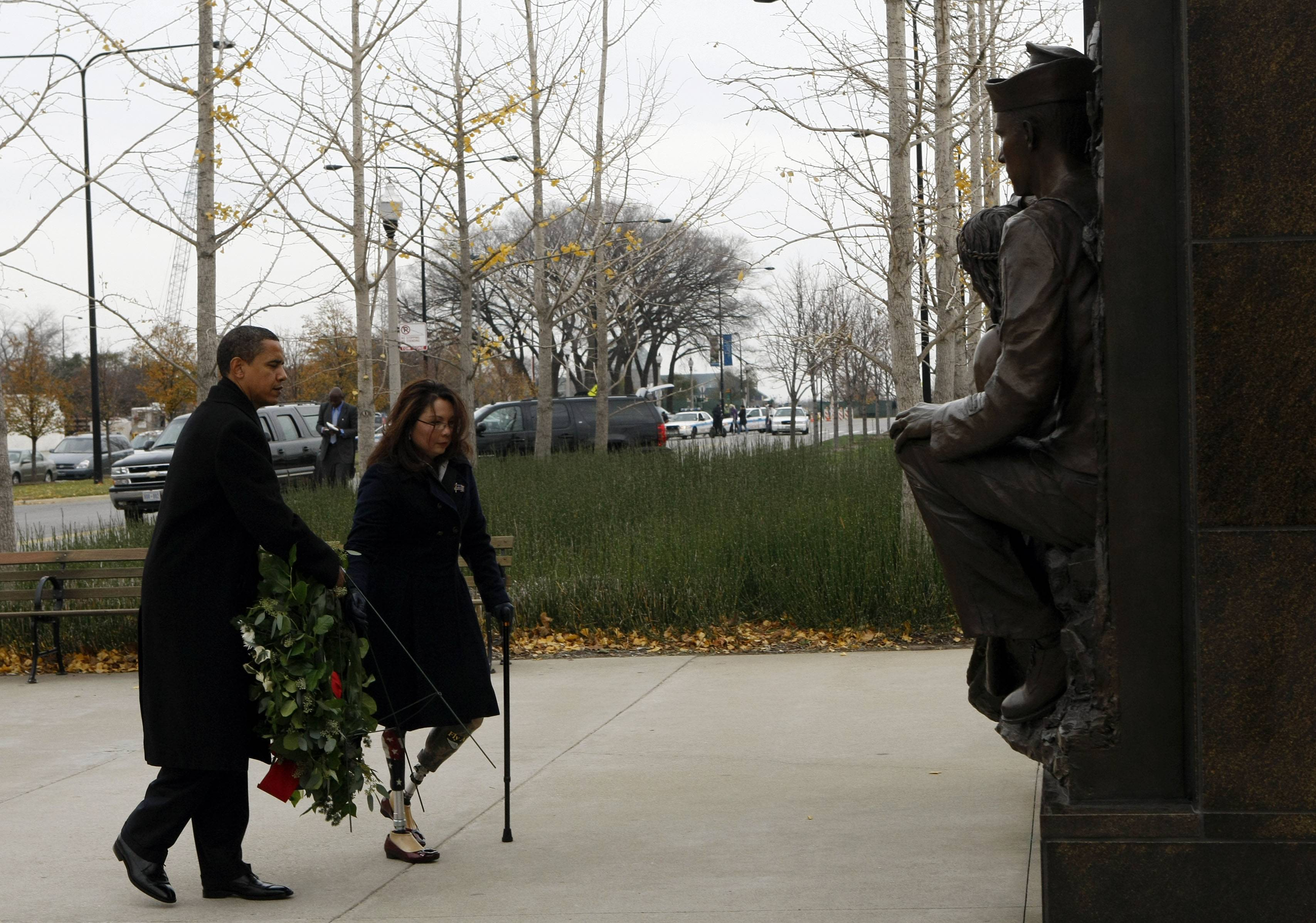 In 2008, president-elect Barack Obama and Democrat Tammy Duckworth, then director of the Illinois Department of Veterans' Affairs, take part in a wreath-laying ceremony at the Bronze Soldiers Memorial in honor of Veterans Day. Duckworth, who later worked as assistant secretary of the federal VA, called for Secretary Eric Shinseki to be replaced Friday.