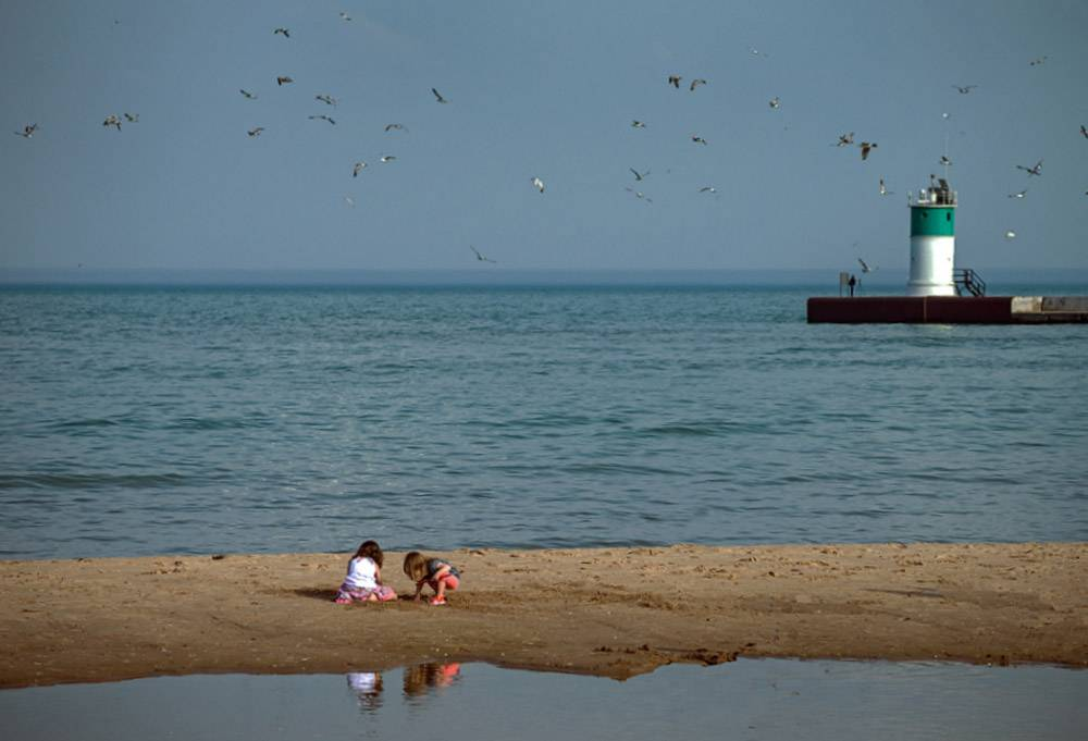 Children play at the beach on North Beach in Waukegan at the beginning of May.