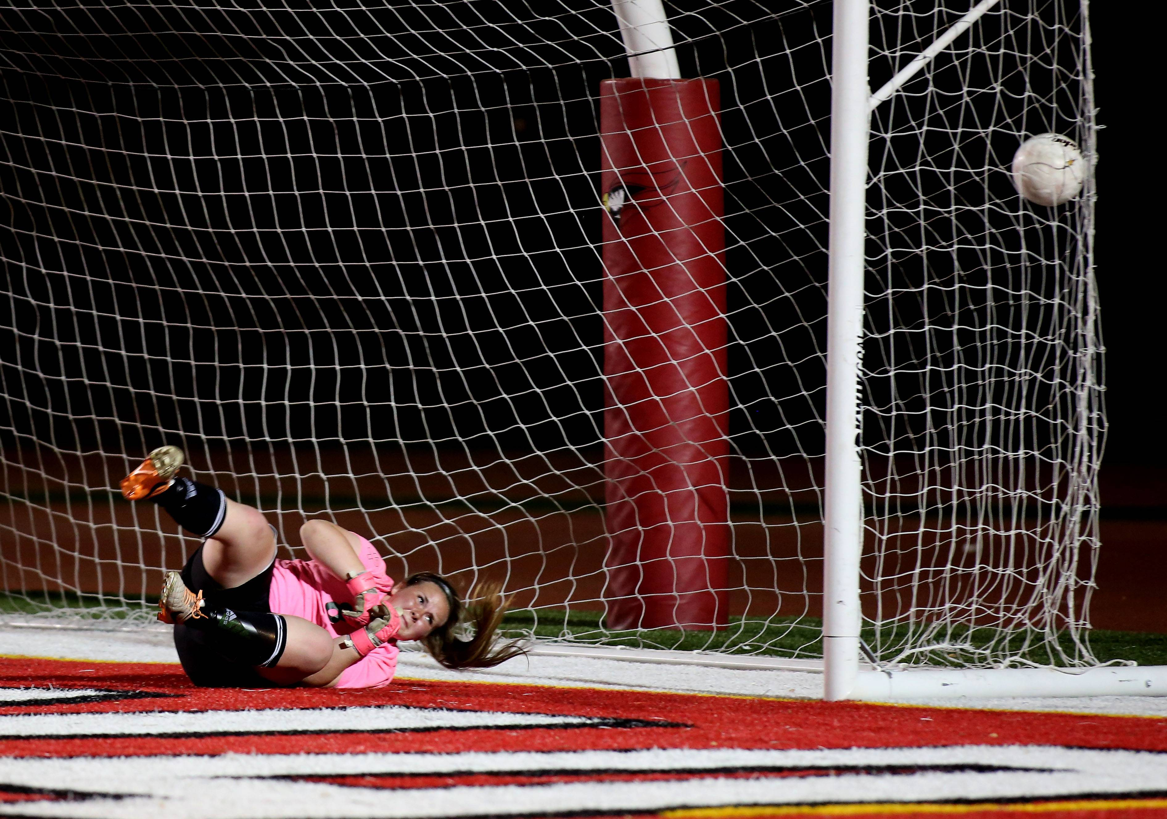 A ball gets by St. Edward goalkeeper Paige Dykstra during penalty kicks in overtime action against Manteno during the Class 1A state soccer semifinals at North Central College in Naperville on Friday.