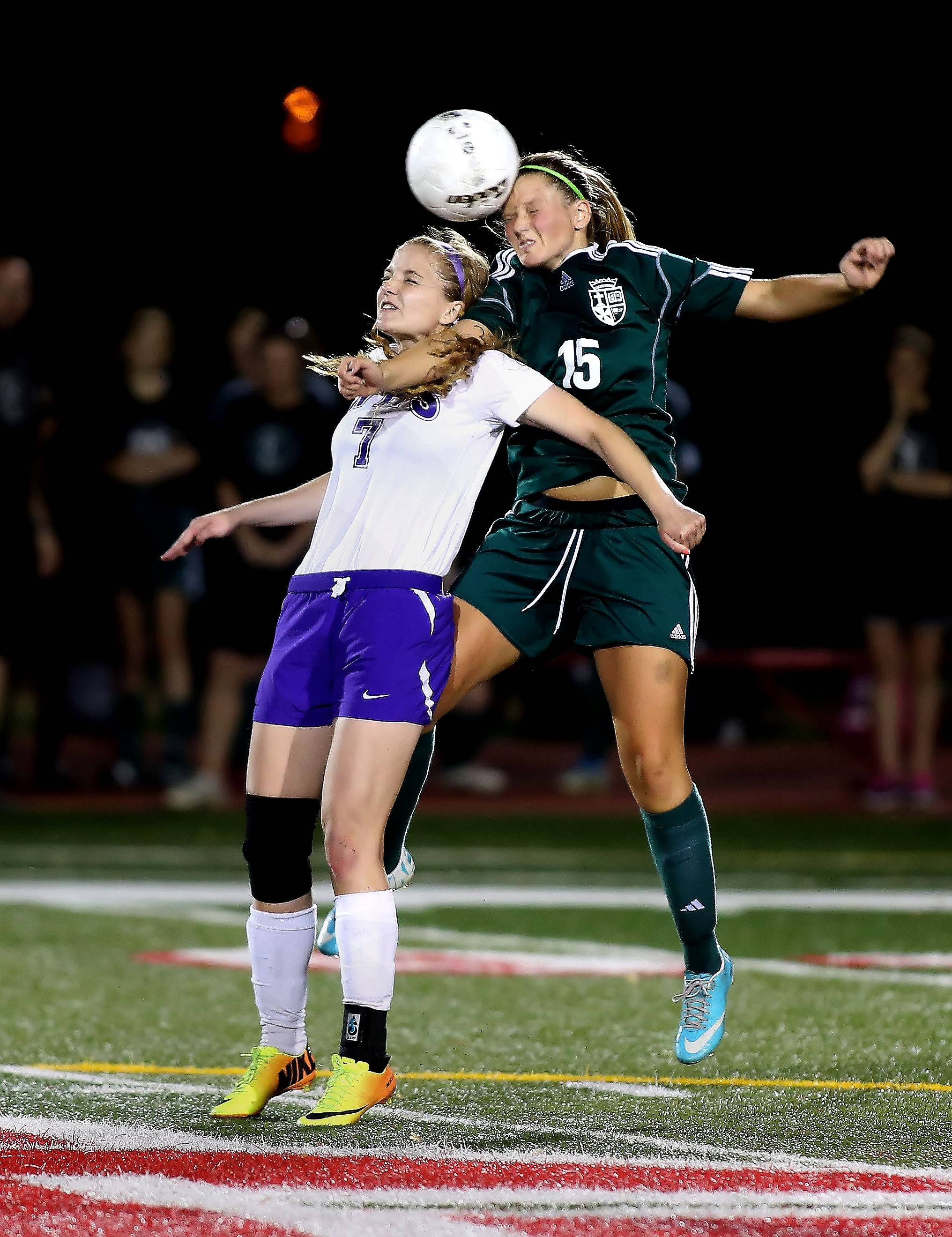 St. Edward's Emily Witt, right, gets to the header over Manteno's Emily Gaither during the Class 1A state soccer semifinals at North Central College in Naperville on Friday.
