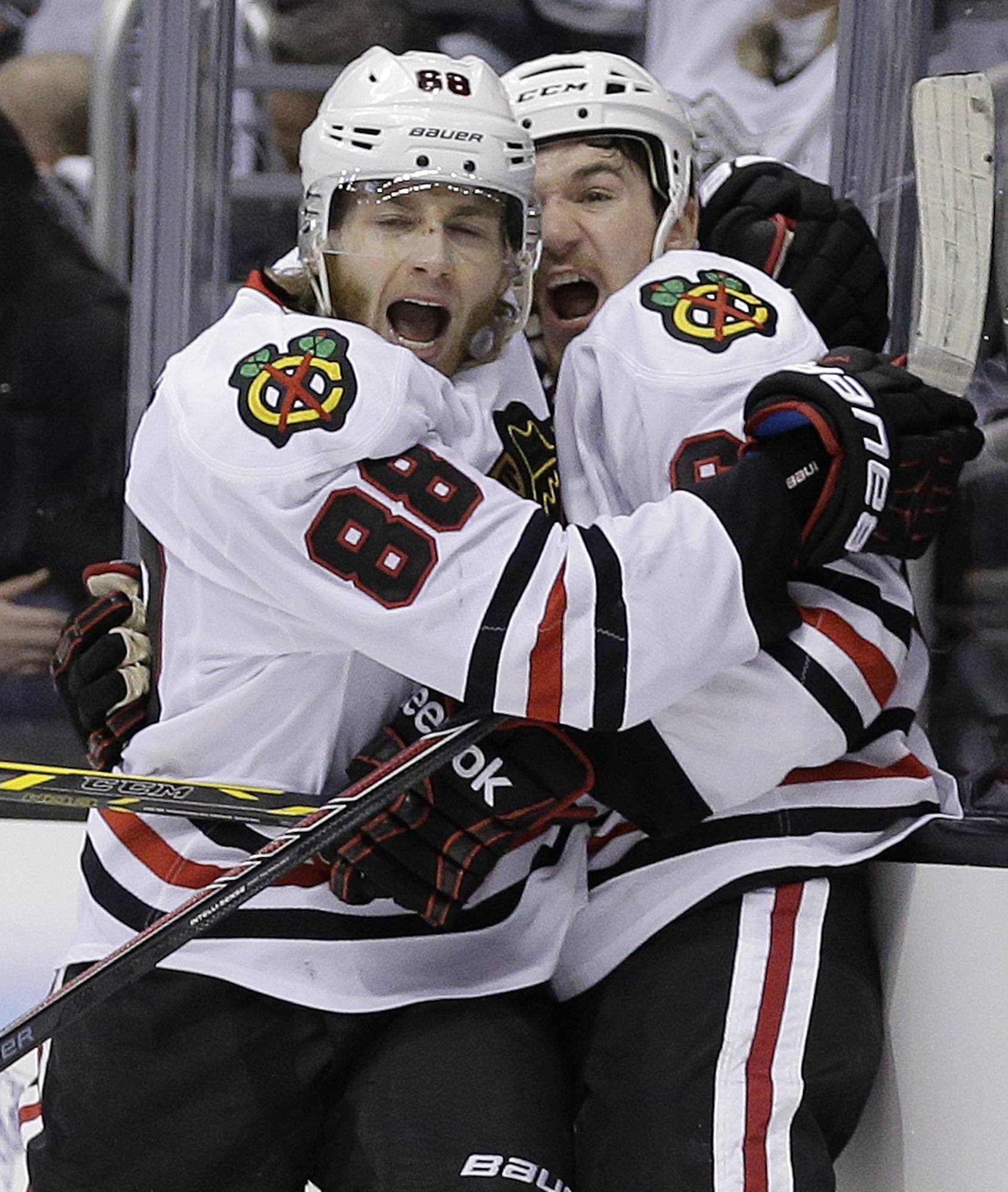 Chicago Blackhawks right wing Patrick Kane, left, celebrates his tie-breaking goal with center Andrew Shaw against the Los Angeles Kings during the third period.