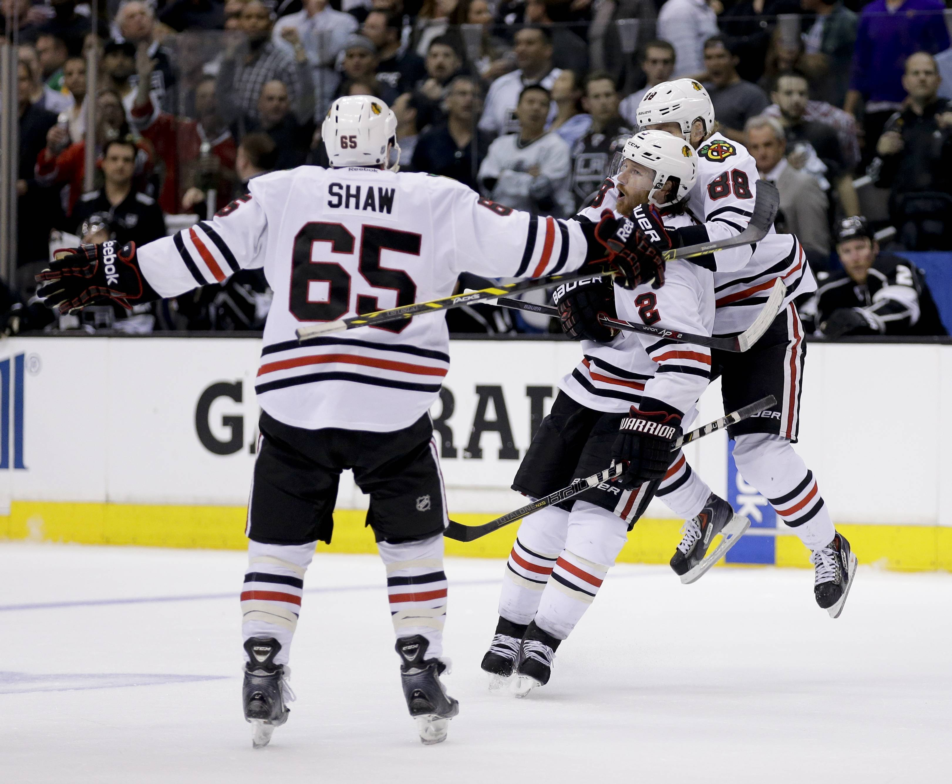 Chicago Blackhawks defenseman Duncan Keith, middle, celebrates his goal against the Los Angeles Kings with Andrew Shaw, left, and Patrick Kane during the third period.