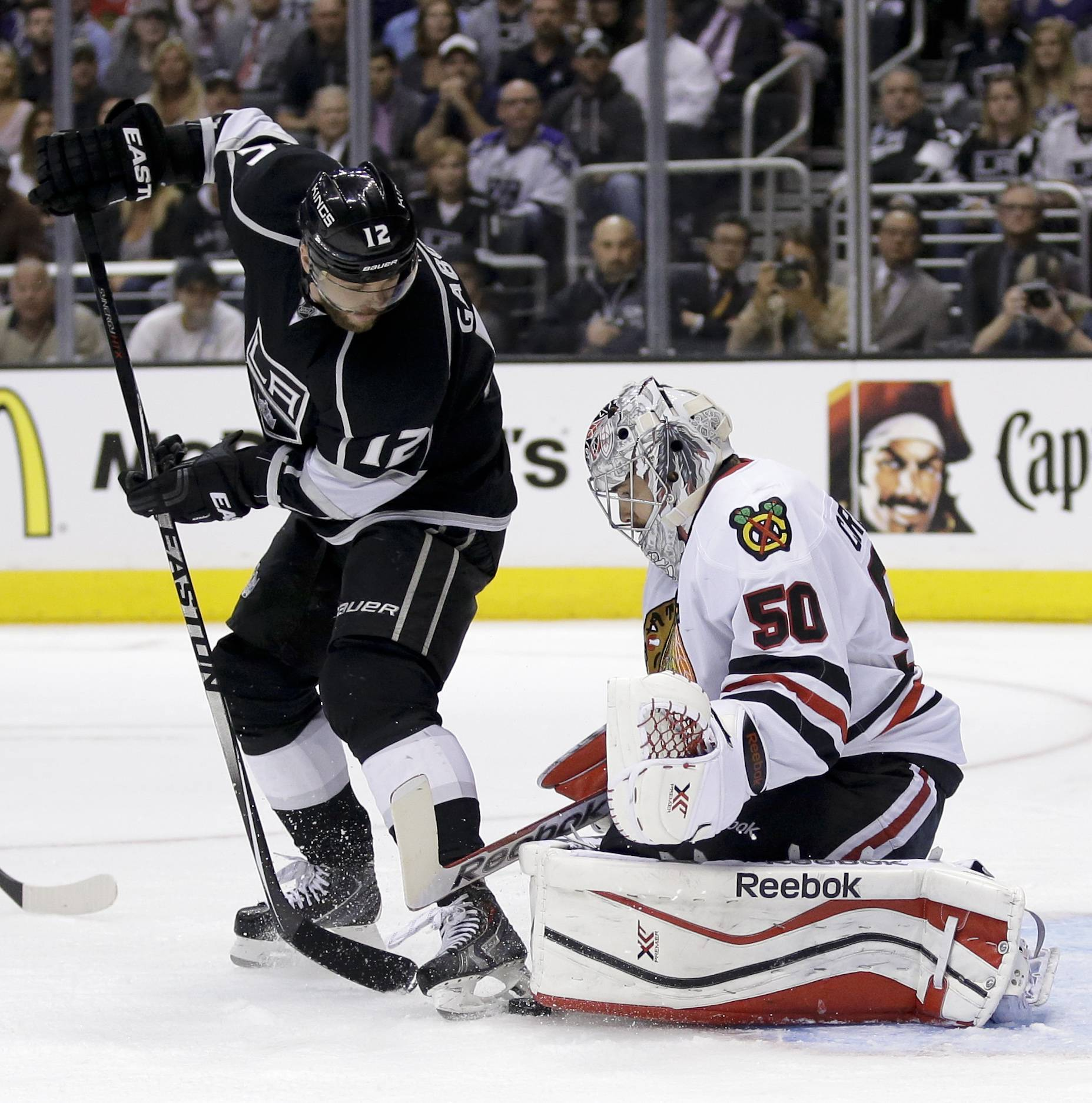 Chicago Blackhawks goalie Corey Crawford, right, blocks a shot by Los Angeles Kings right wing Marian Gaborik during the second period.