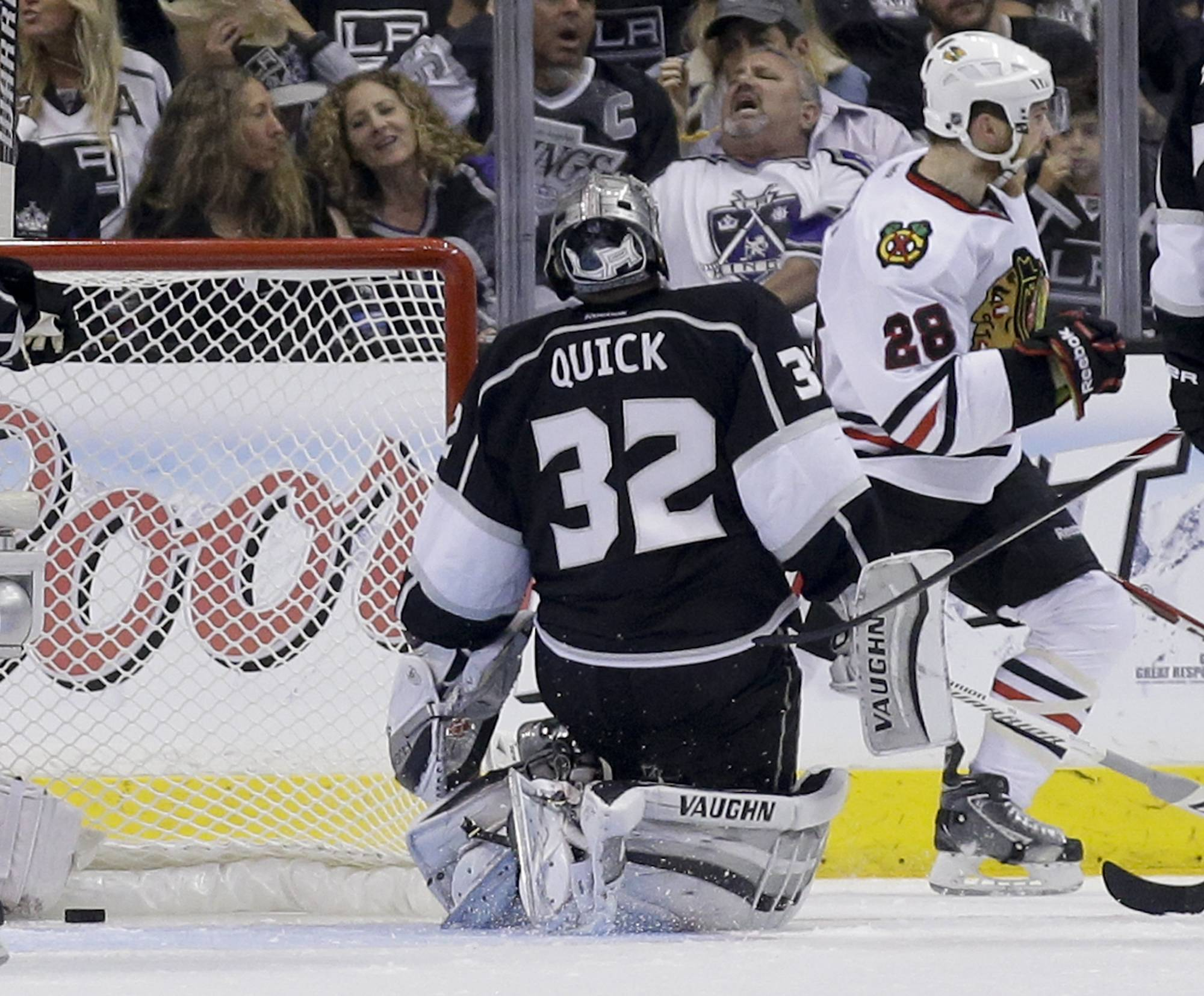 Chicago Blackhawks right wing Ben Smith, right, celebrates after scoring on Los Angeles Kings goalie Jonathan Quick during the second period.