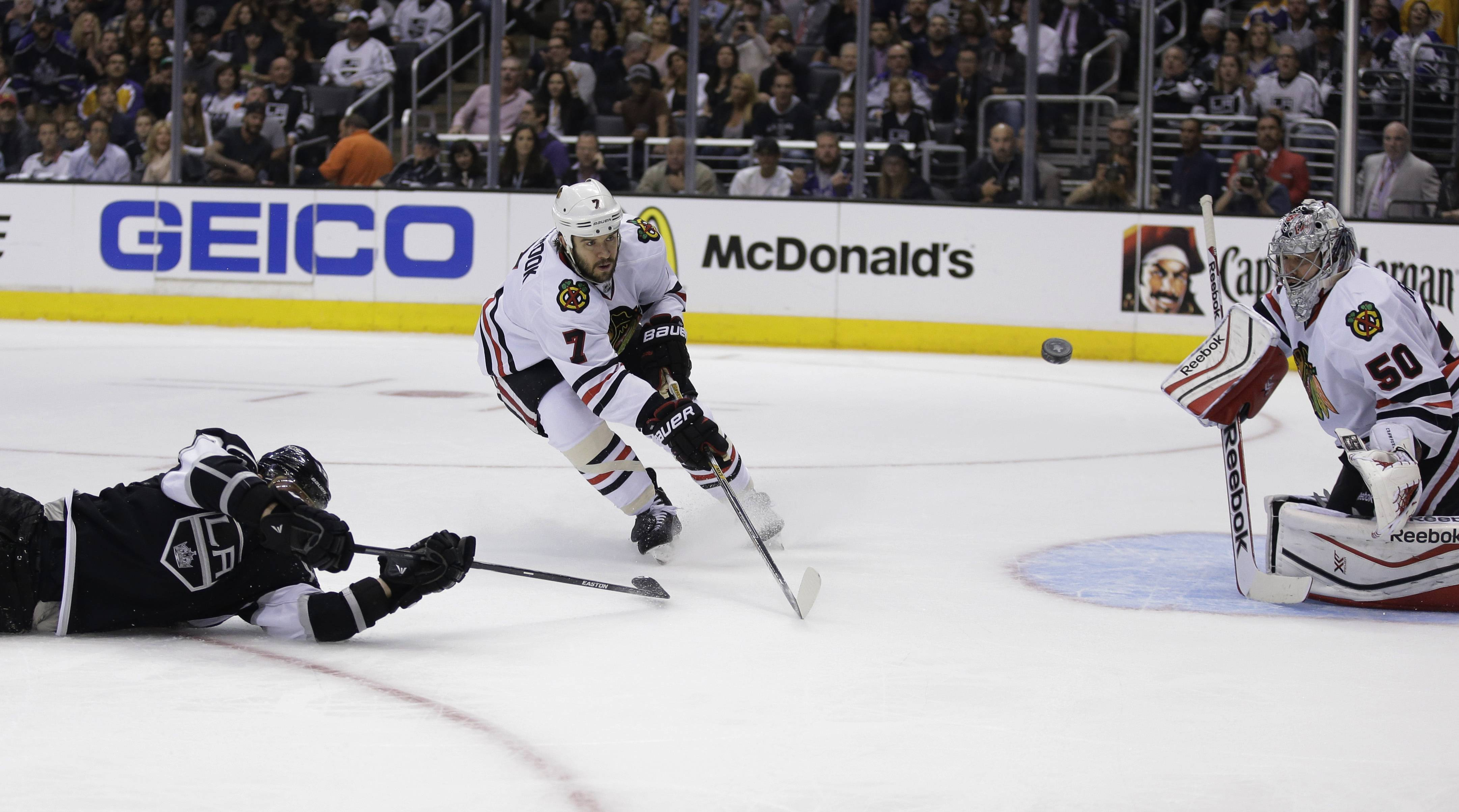 Chicago Blackhawks goalie Corey Crawford blocks a shot by Los Angeles Kings right wing Marian Gaborik, left, as defenseman Brent Seabrook wathes during the second period.