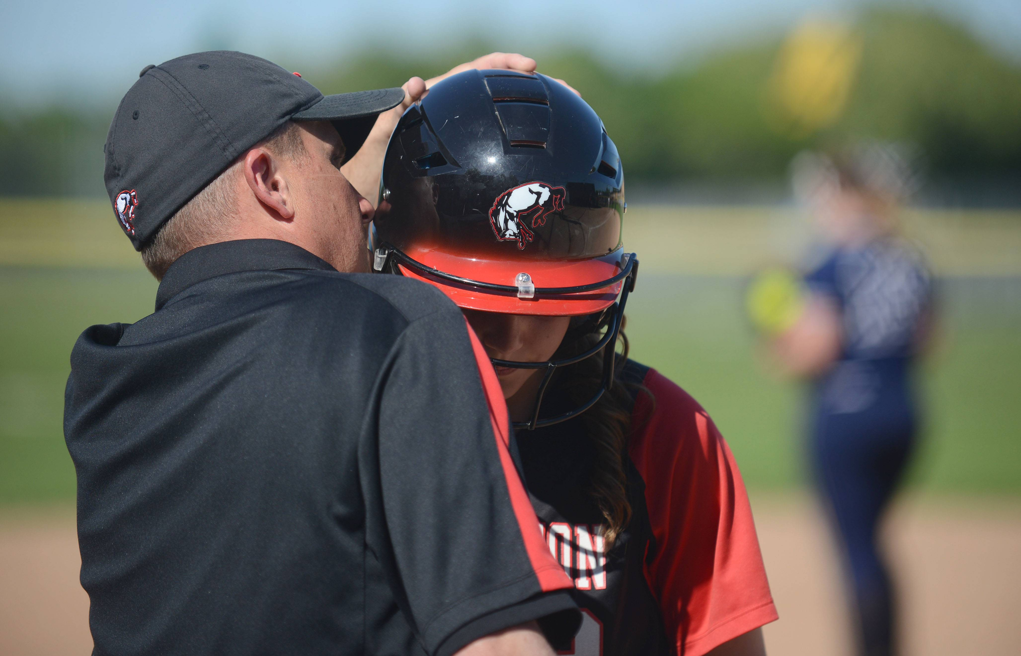 Barrington head coach Perry Peterson takes Katie Dehnert aside before she goes up to bat in the third inning vs. Cary-Grove in the Class 4A girls softball regional championship in Cary on Friday, May 30.