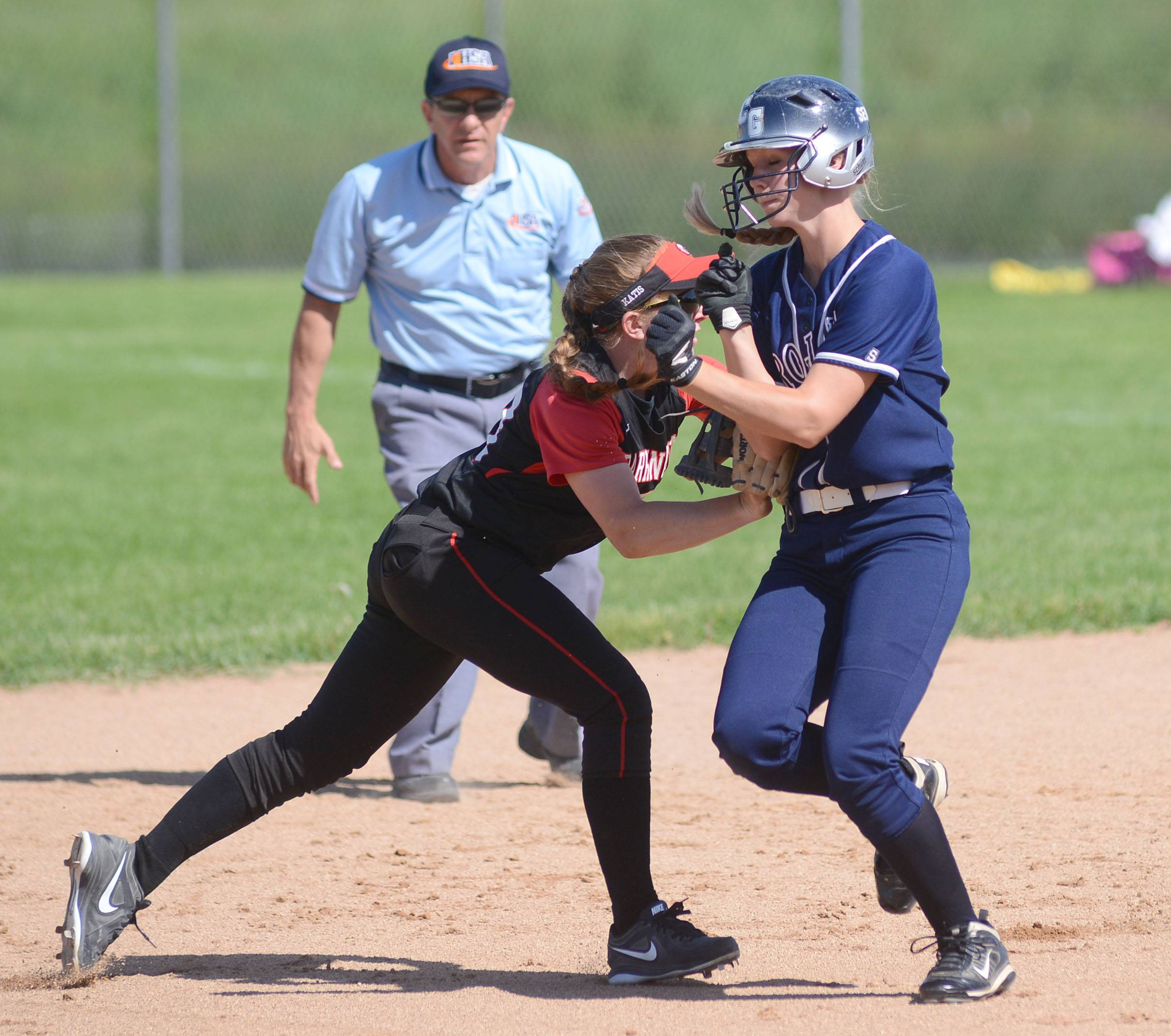 Barrington's Kelly Katis tags out Lisa Semro on her way to second base in the Class 4A girls softball regional championship in Cary on Friday, May 30.
