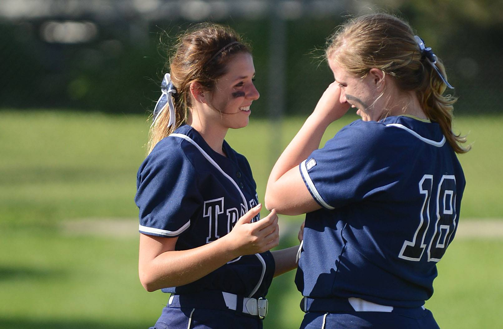 Cary-Grove's Colleen Kaveney, left, comforts teary-eyed teammate Caroline Zasadil after their 10-0 loss to Barrington in the Class 4A girls softball regional championship in Cary on Friday, May 30.