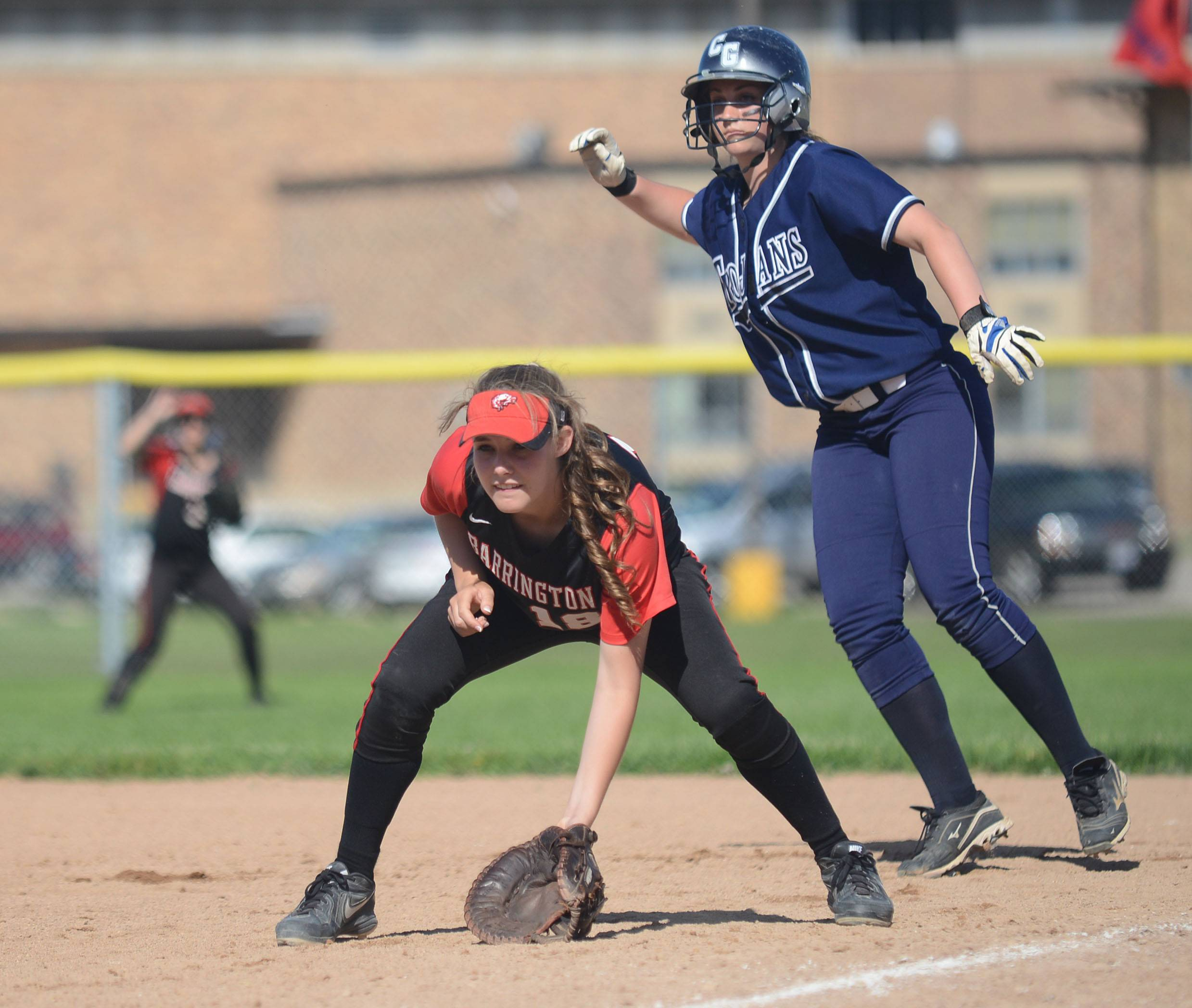 Cary-Grove's Caitlyn Adams leads off first and away from Barrington's Katie Dehnert in the fourth inning of the Class 4A girls softball regional championship in Cary on Friday, May 30.