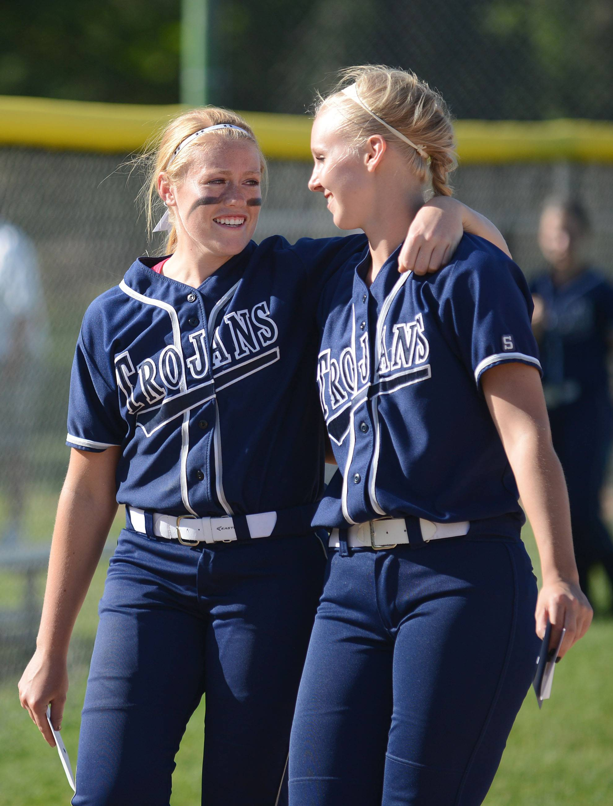 Cary-Grove's Kat Panos, left, and Liz Sweeney leave the field together after the Trojans' loss to Barrington in the Class 4A girls softball regional championship in Cary on Friday, May 30.