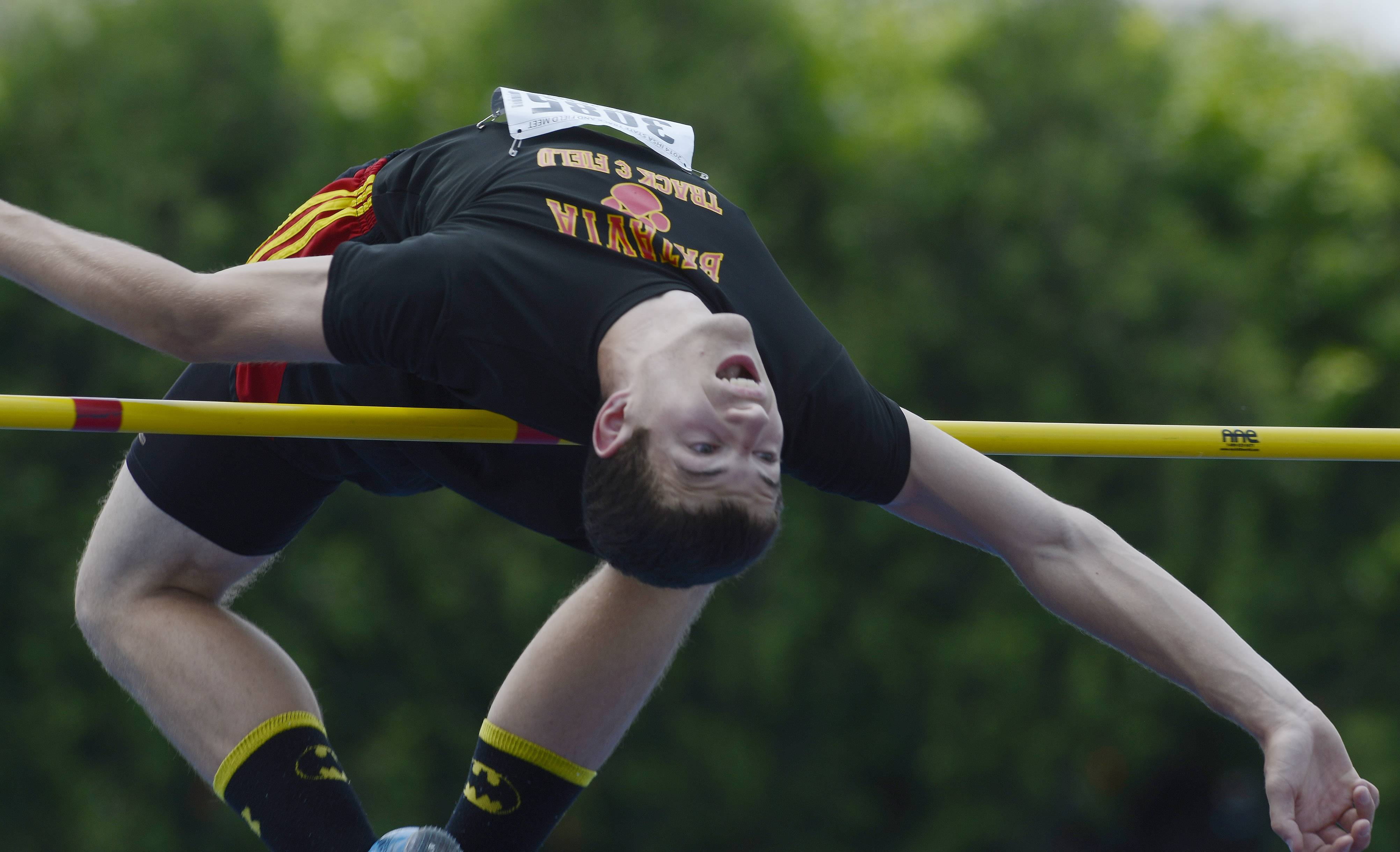 Batavia's Mark Rudelich clears the high jump bar at 6 feet, 4 inches during the Class 3A boys track and field state preliminaries in Charleston on Friday.