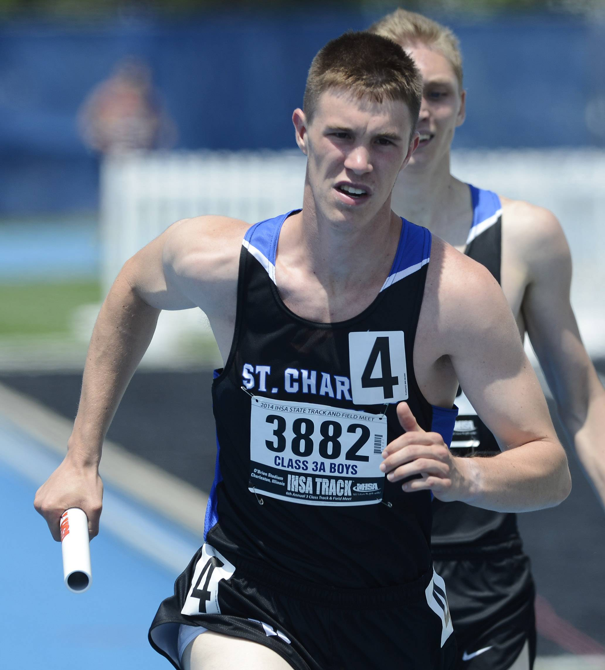St. Charles North's Nathan Klair carries the baton for his team in the 4x800-meter relay during the Class 3A boys track and field state preliminaries in Charleston on Friday.