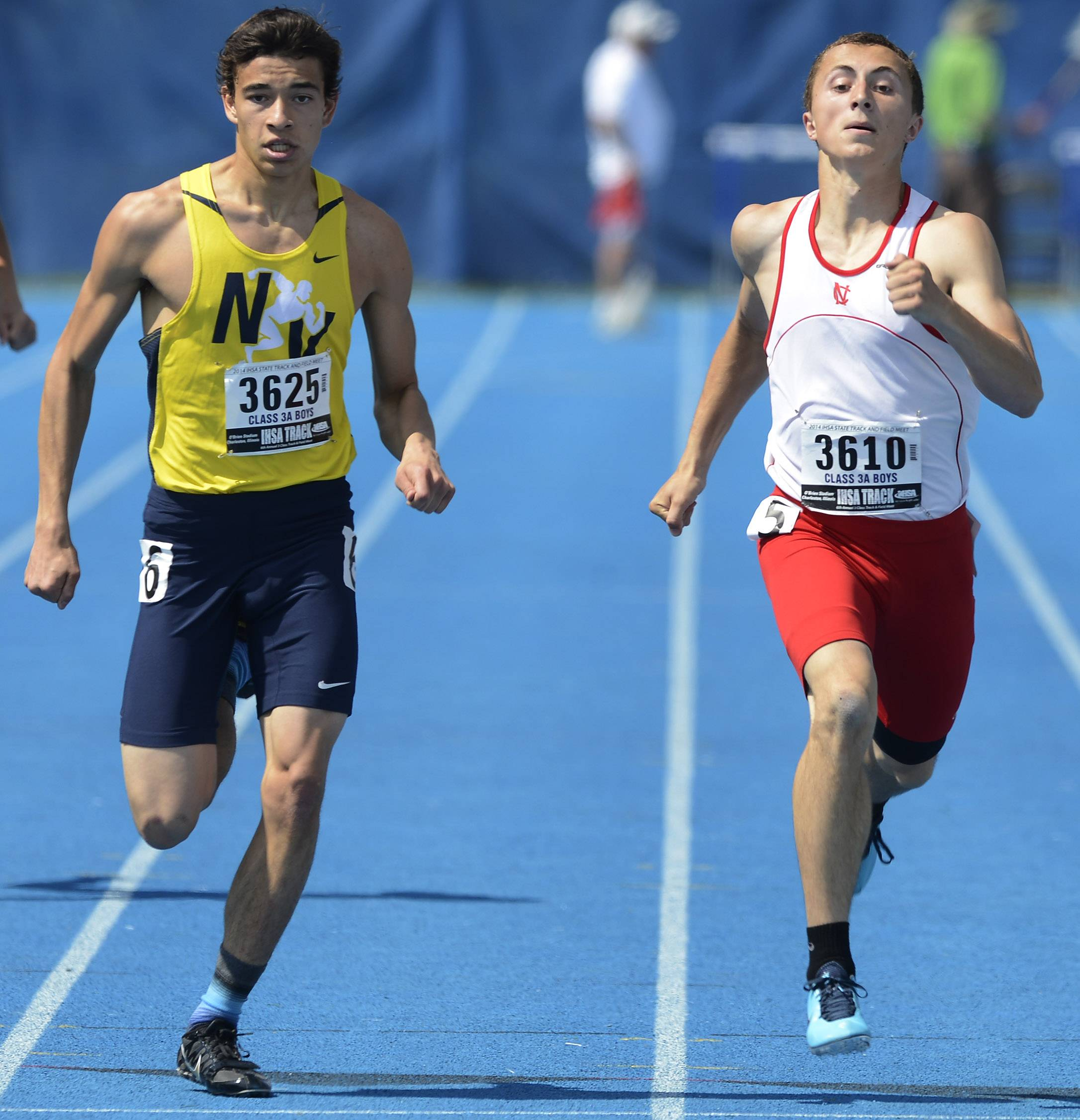 Neuqua Valley's Zac Espinosa, left, and Naperville Central's Sam Bransby run in adjacent lanes in the 400-meter dash during the boys class 3A state track and field preliminaries in Charleston Friday.