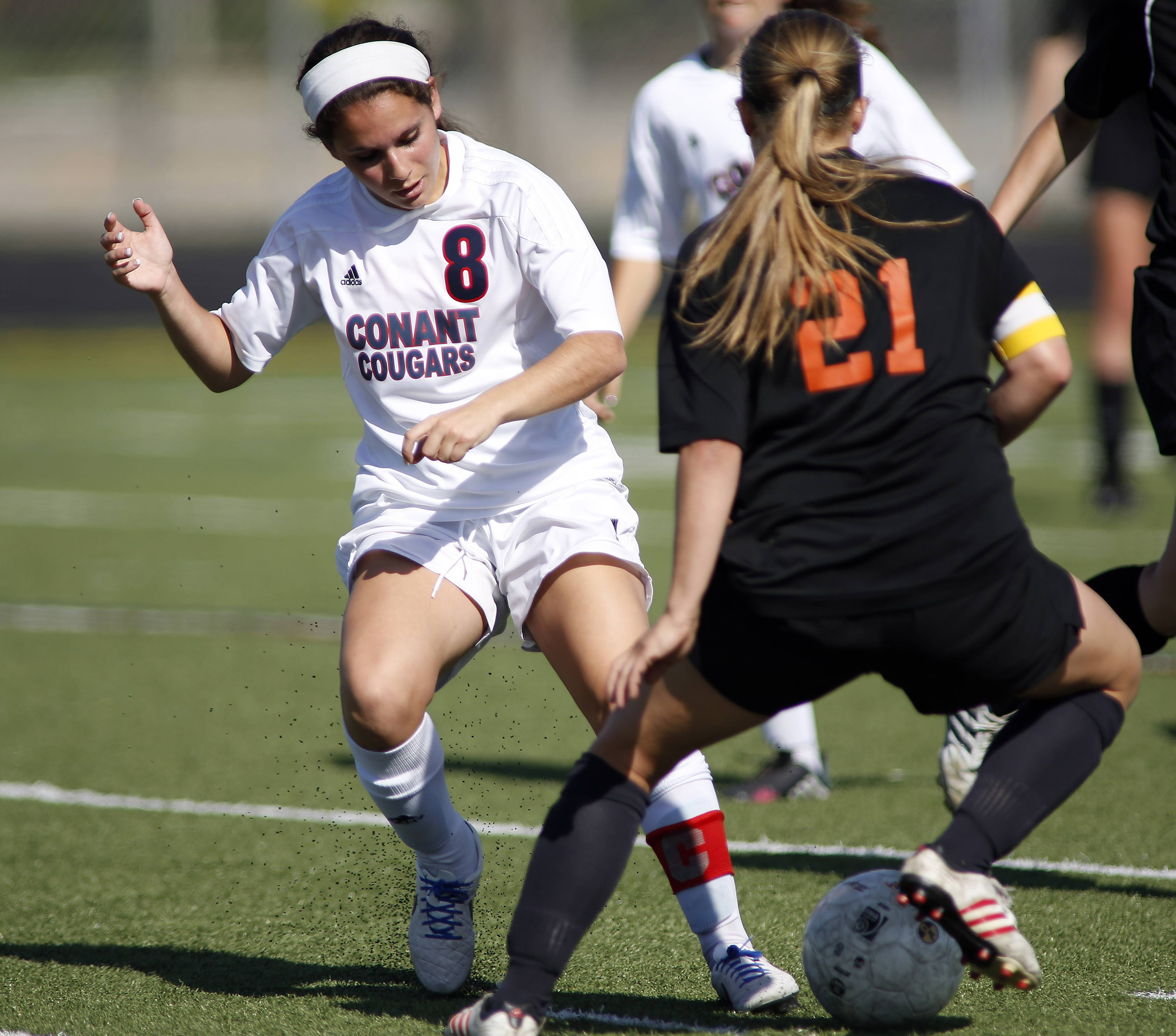 Conant's Bianca Madonia pressures St. Charles East's Amanda Hilton during Friday's sectional final at Conant.