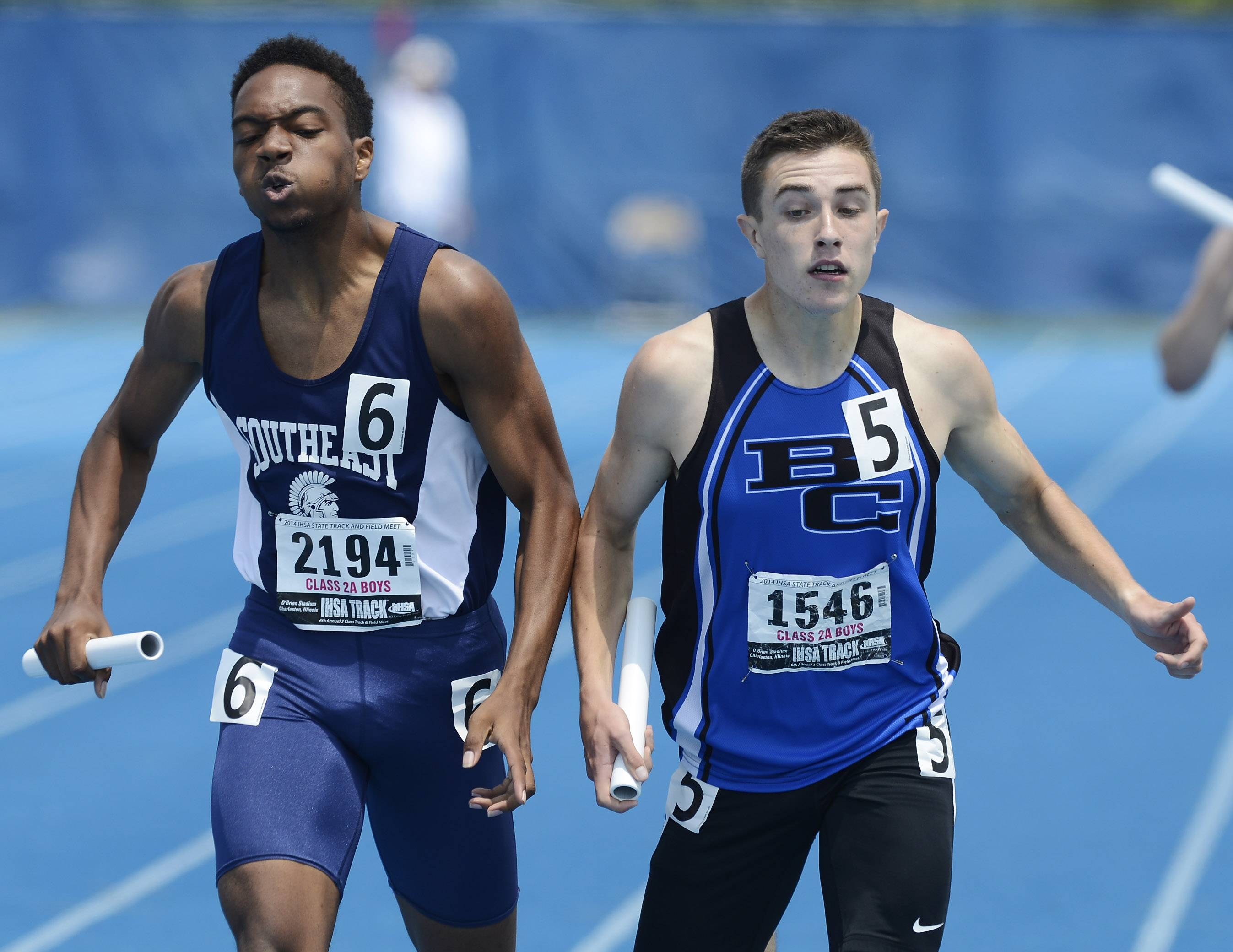 Matt O' Connor, right, of Burlington Central just edges Troy Bunch of Springfield Southeast at the finish of the 4x400 relay during the Class 2A boys track and field state preliminaries in Charleston on Friday.