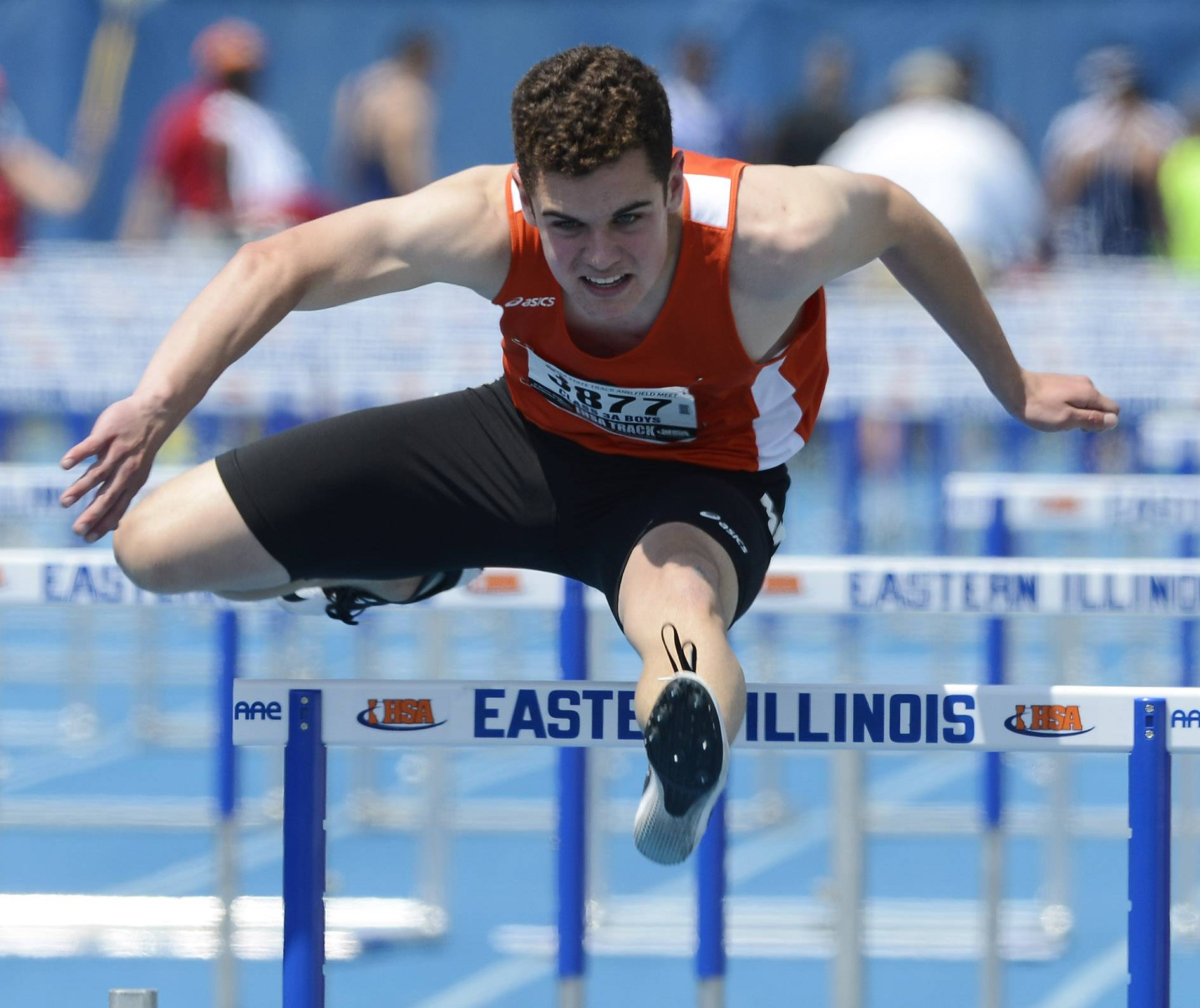 St. Charles East's Kyle Decker clears the last hurdle in the 110-meter high hurdles during the boys Class 3A state track and field preliminaries in Charleston Friday.