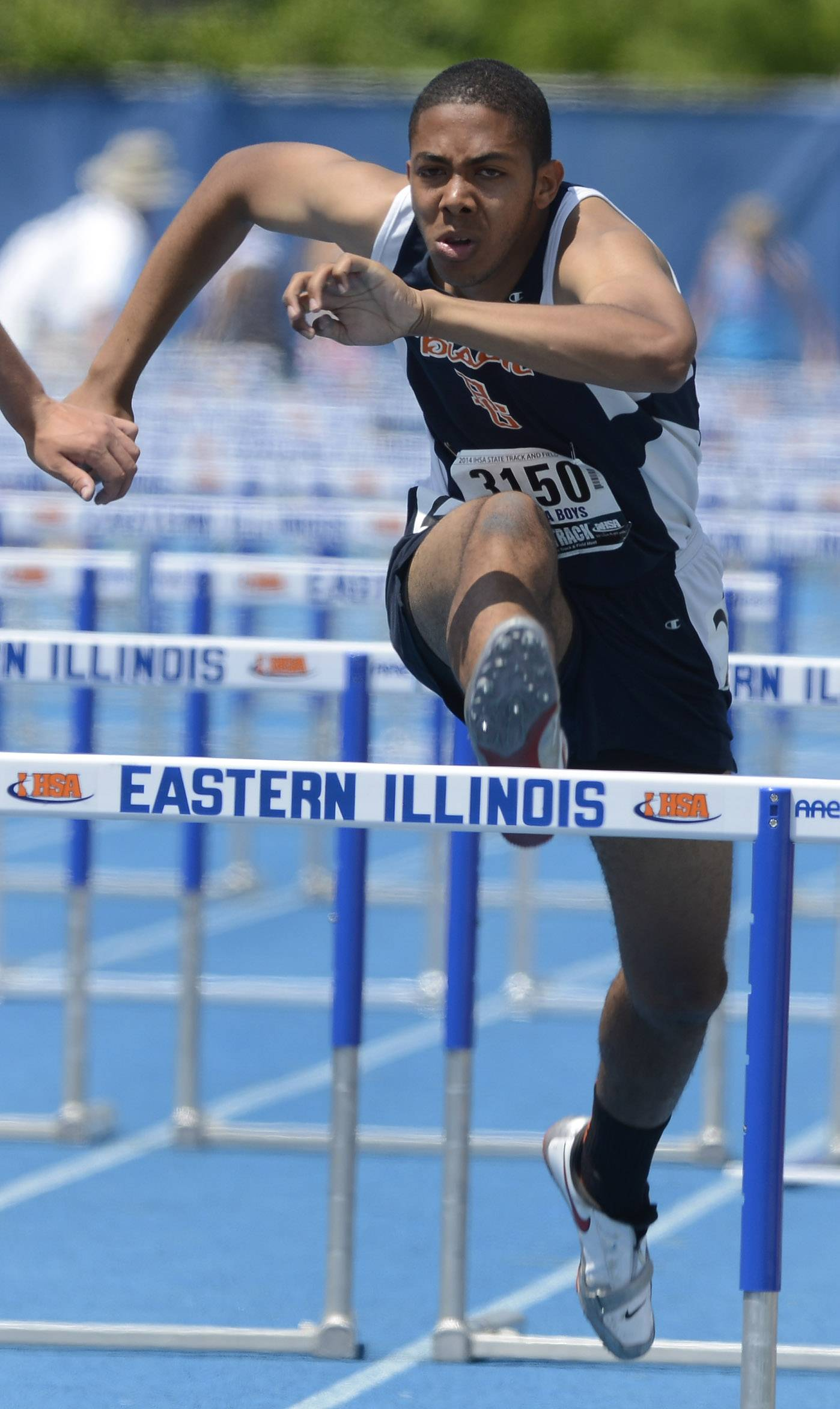 Buffalo Grove's Maurice Beryozkin clears the last hurdle while competing in the 110-meter high hurdles during the boys Class 3A state track and field preliminaries in Charleston Friday.