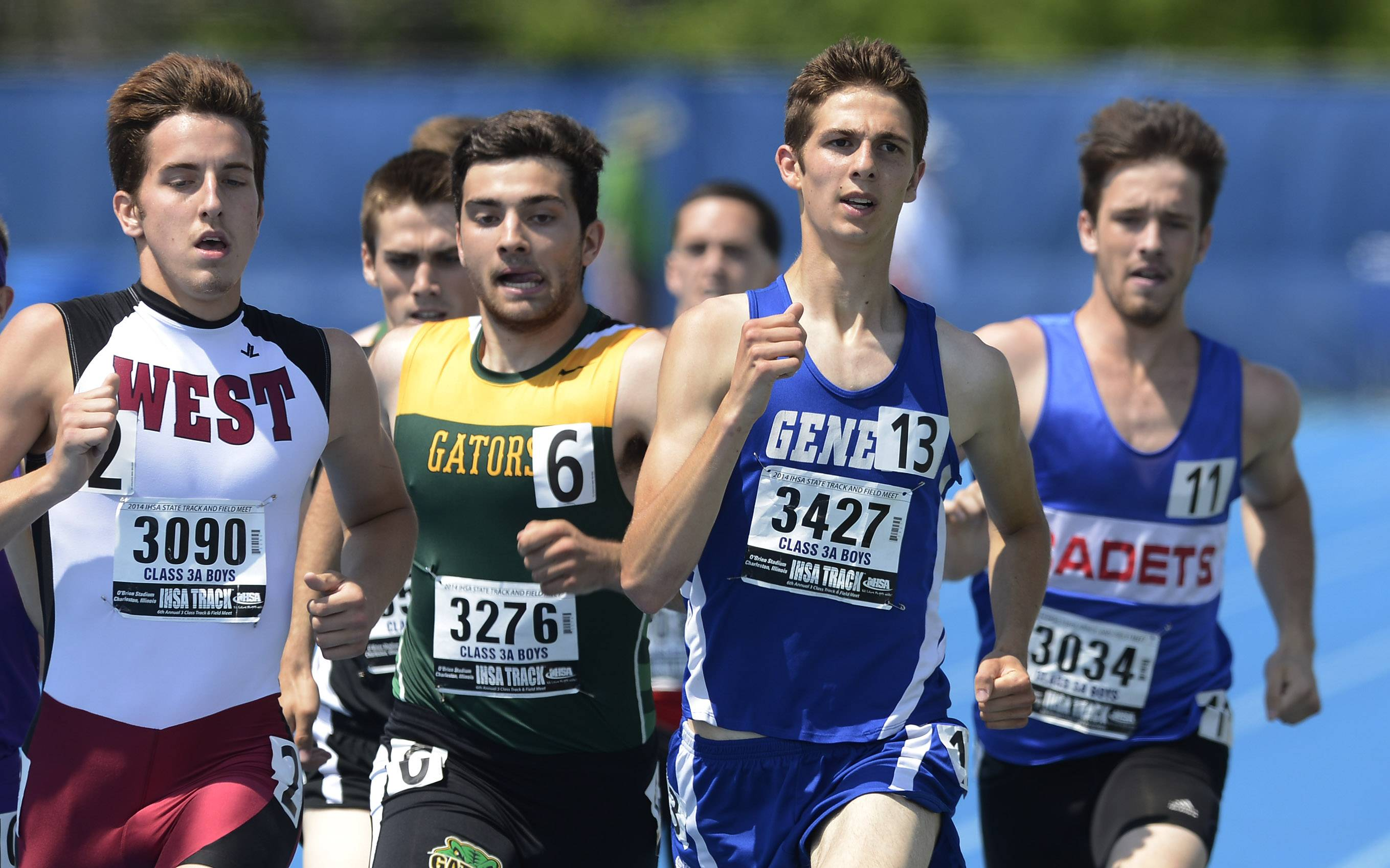 Geneva's Blaine Bartel, second from right, leads the pack after the first 400 meters in the 800-meter relay during the boys Class 3A state track and field preliminaries in Charleston Friday.