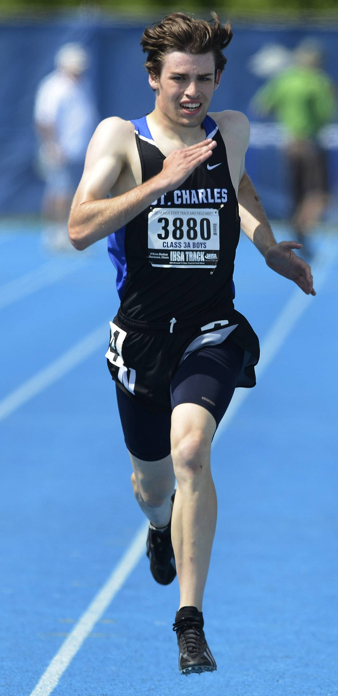 St. Charles North's Jack Feeney competes in the 800-meter run during the boys Class 3A state track and field preliminaries in Charleston Friday.