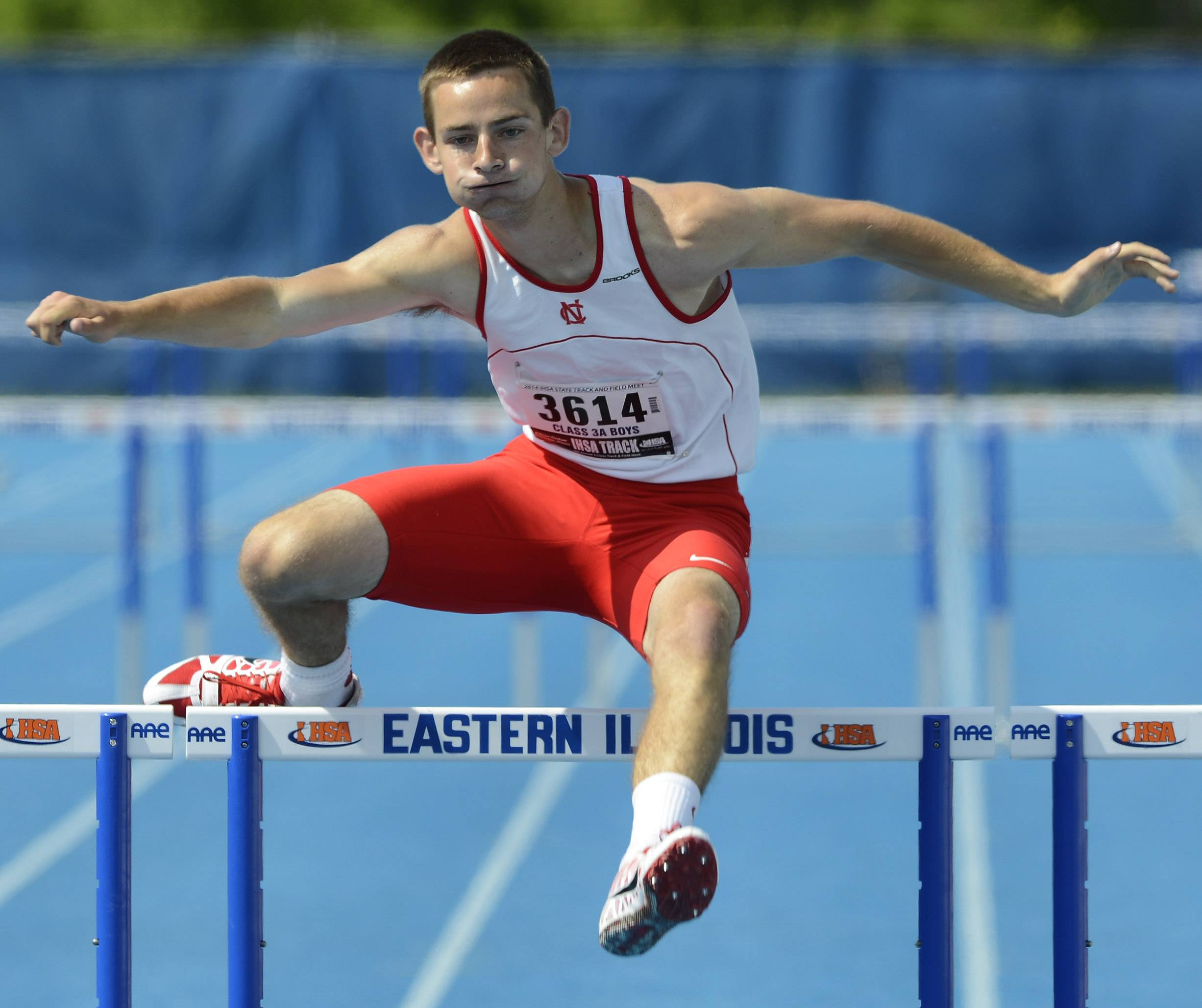 Naperville Central's Michael Jopes crosses the final hurdle while competing in the 300-meter intermediate hurdles during the boys Class 3A state track and field preliminaries in Charleston Friday.