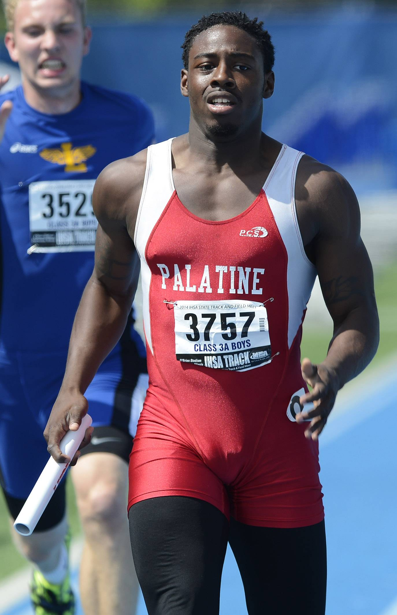 Palatine's Chaka Kelly crosses the finish line while running ion the anchor leg of the 4x200-meter relay during the boys Class 3A state track and field preliminaries in Charleston Friday.